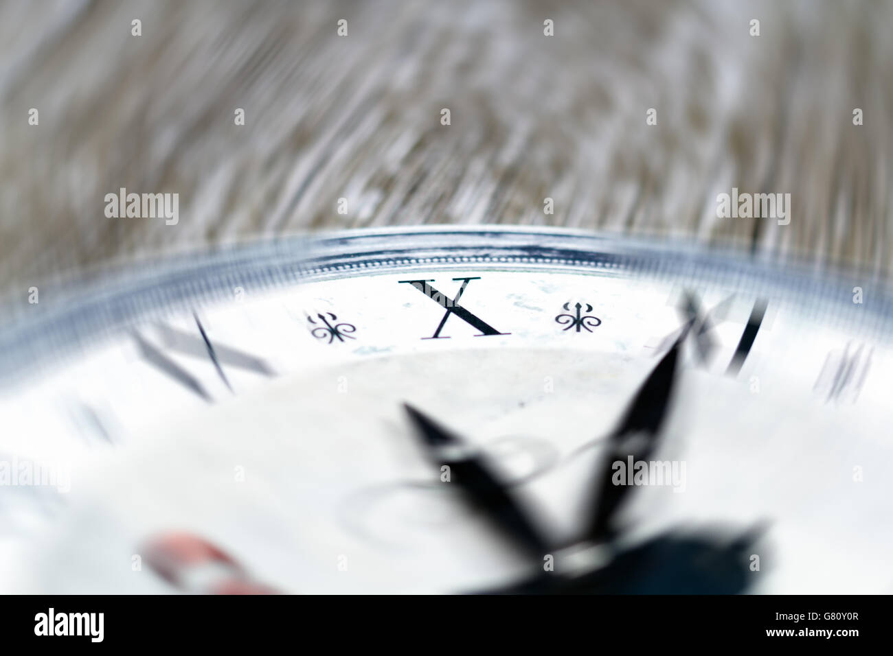 various numbers shown on vintage clock surface - Stock Image