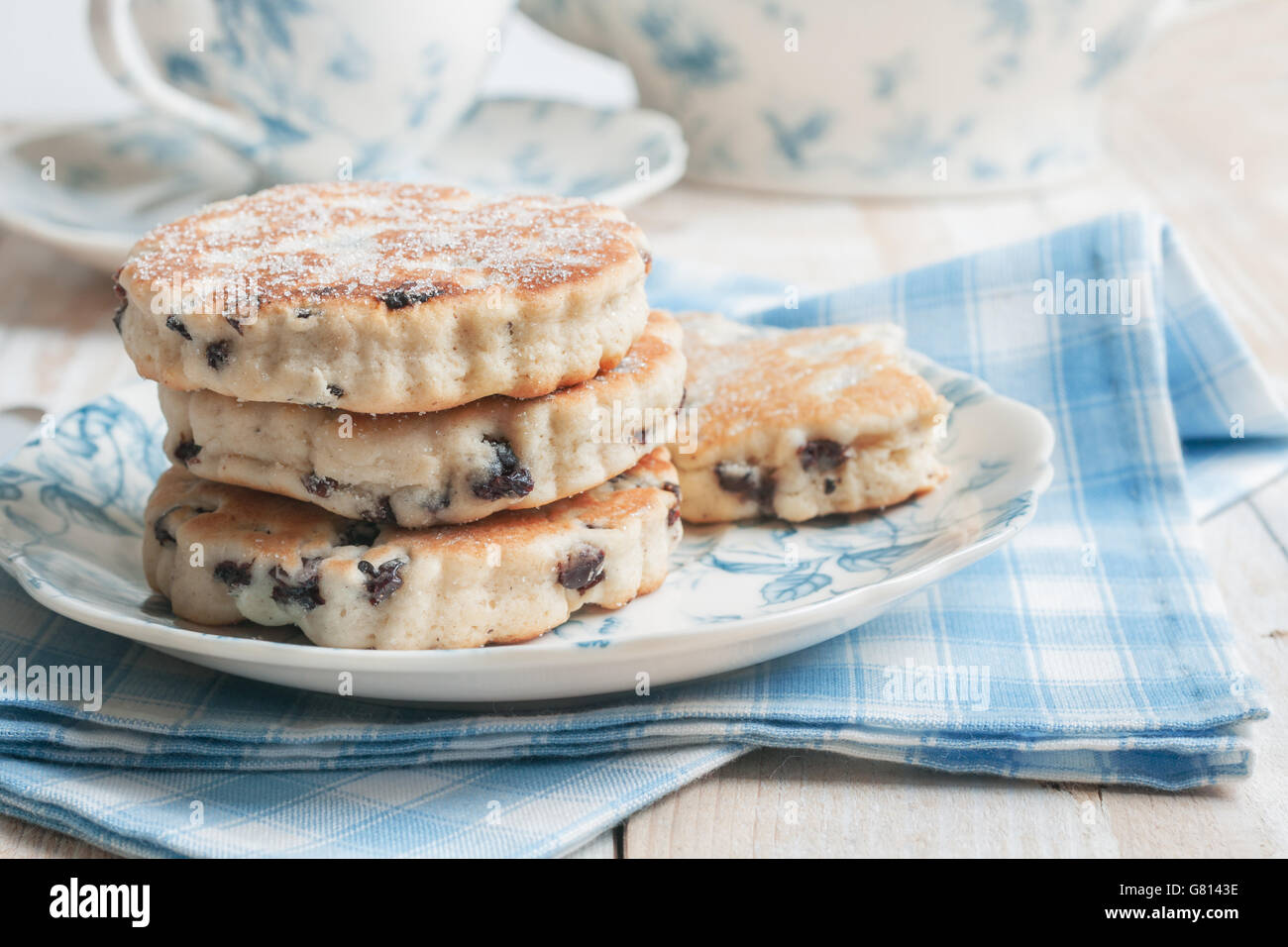 Welsh cakes a traditional griddle cake made with flour and dried fruit then baked on a griddle - Stock Image