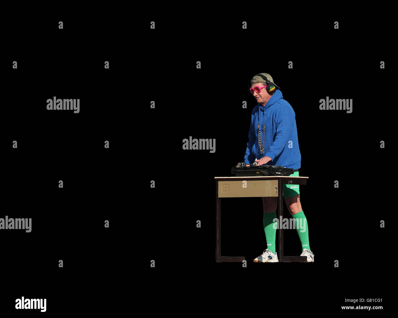 Funny dressed DJ playing music in sports equipement - Stock Image