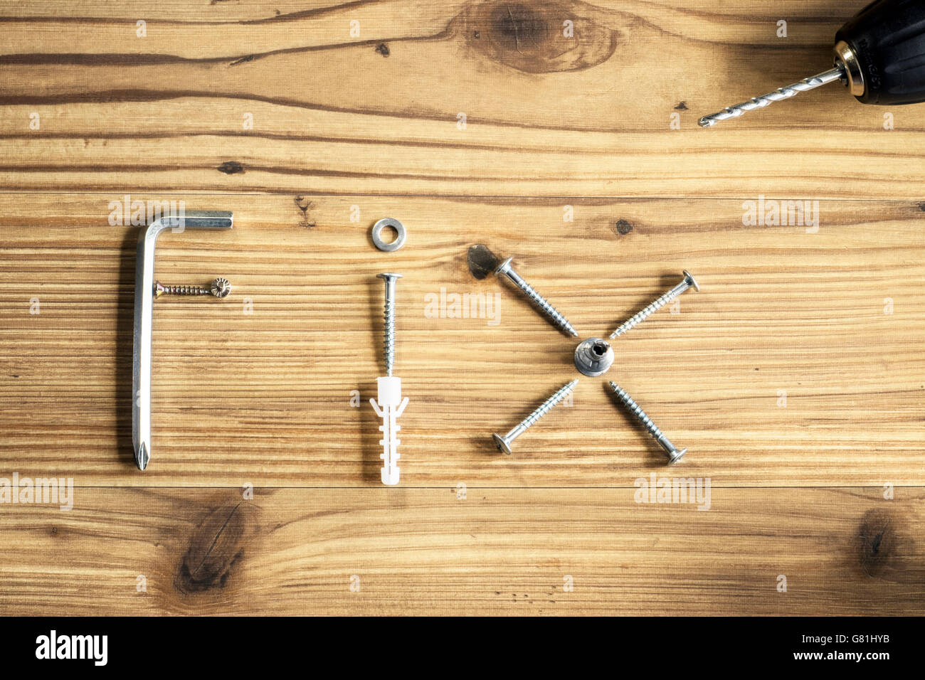Selection of DIY materials to represent the word Fix - Stock Image