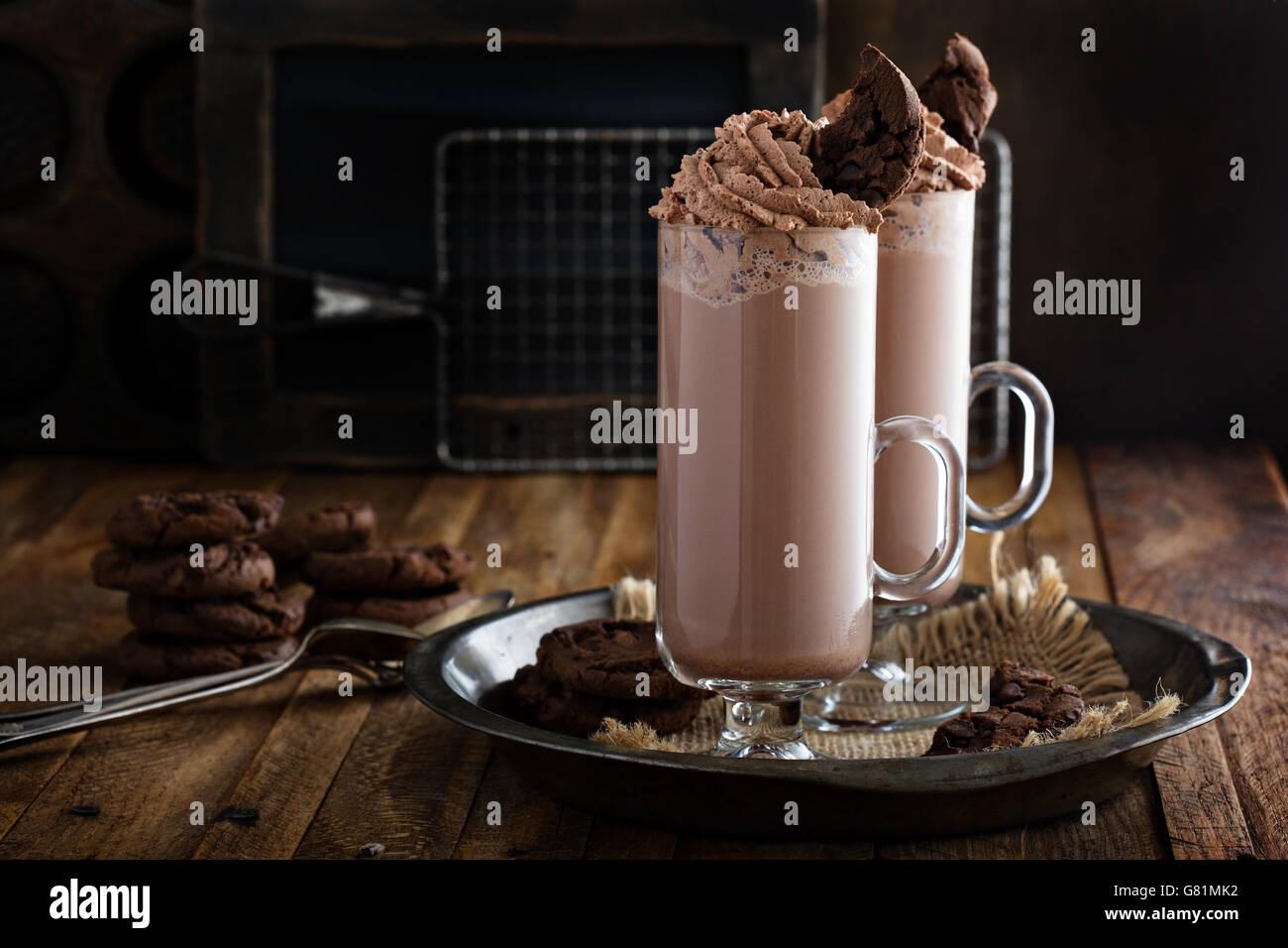Chocolate cookie milkshake in tall mugs - Stock Image