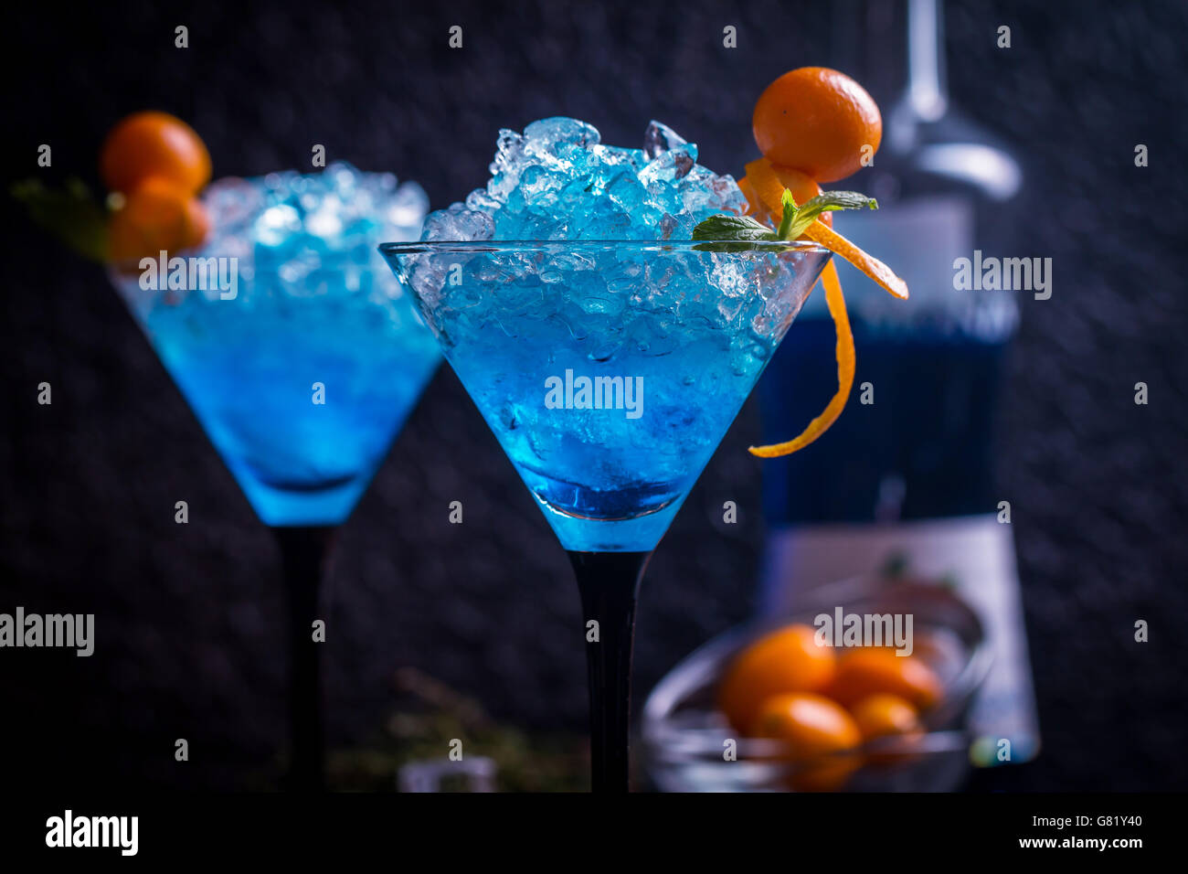 Blue cocktail in martini glasses - Stock Image