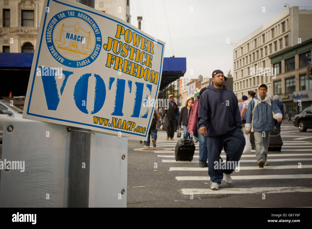 A NAACP sign calls to vote on 125th street in Harlem, New York, USA, on 2008 US presidential Election Day, 4 November - Stock Image