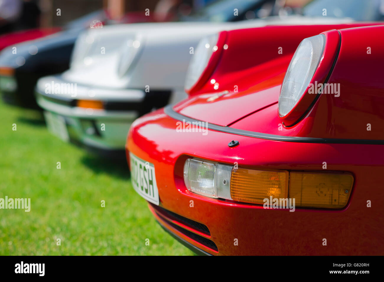Porsche 911 front , detail of the noses of a line of classic 1980s Porsche 911s. - Stock Image