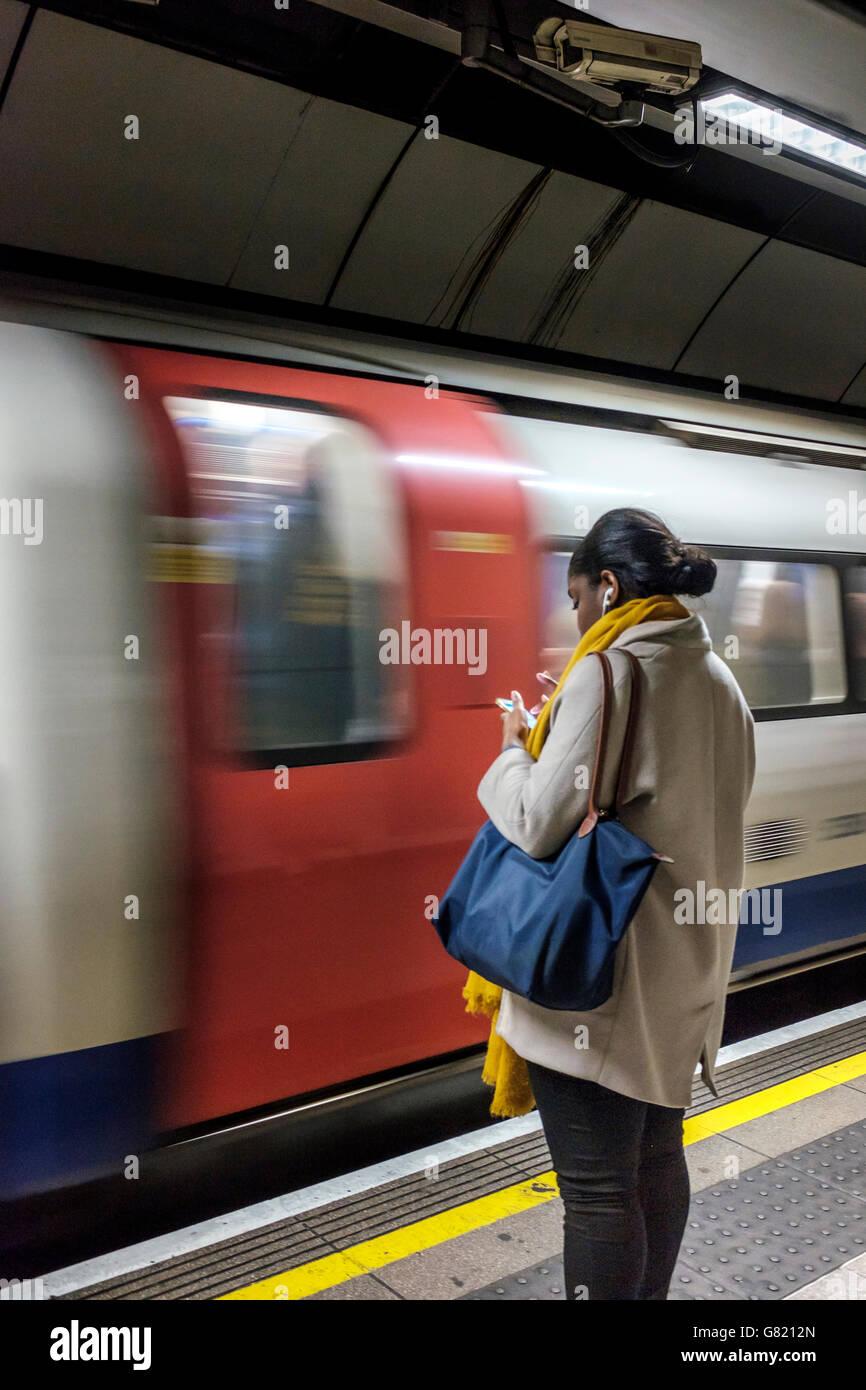 England-Woman on the platform on London Underground - Stock Image