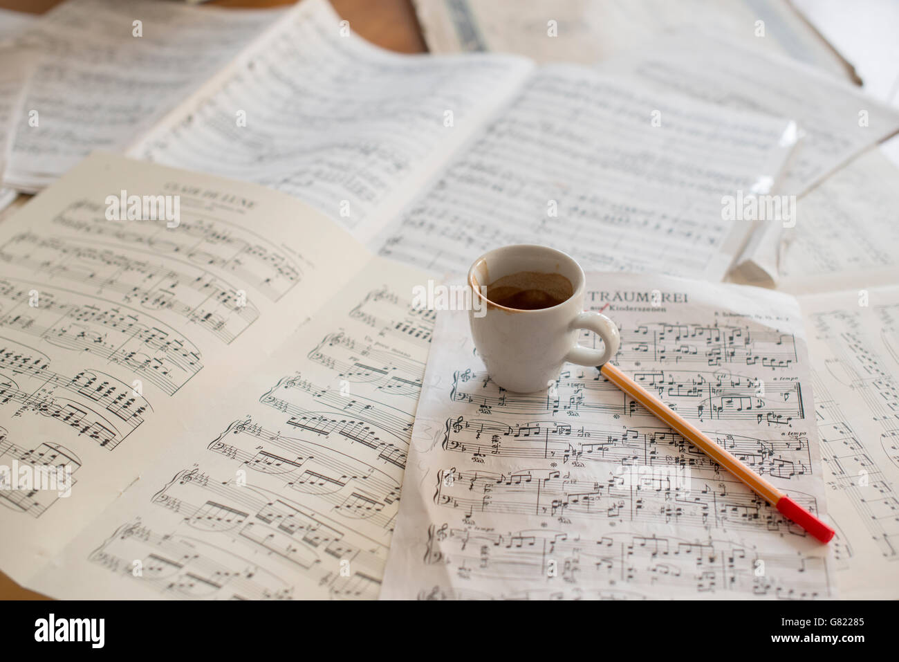 Strong coffee and music score on musicians desk - Stock Image