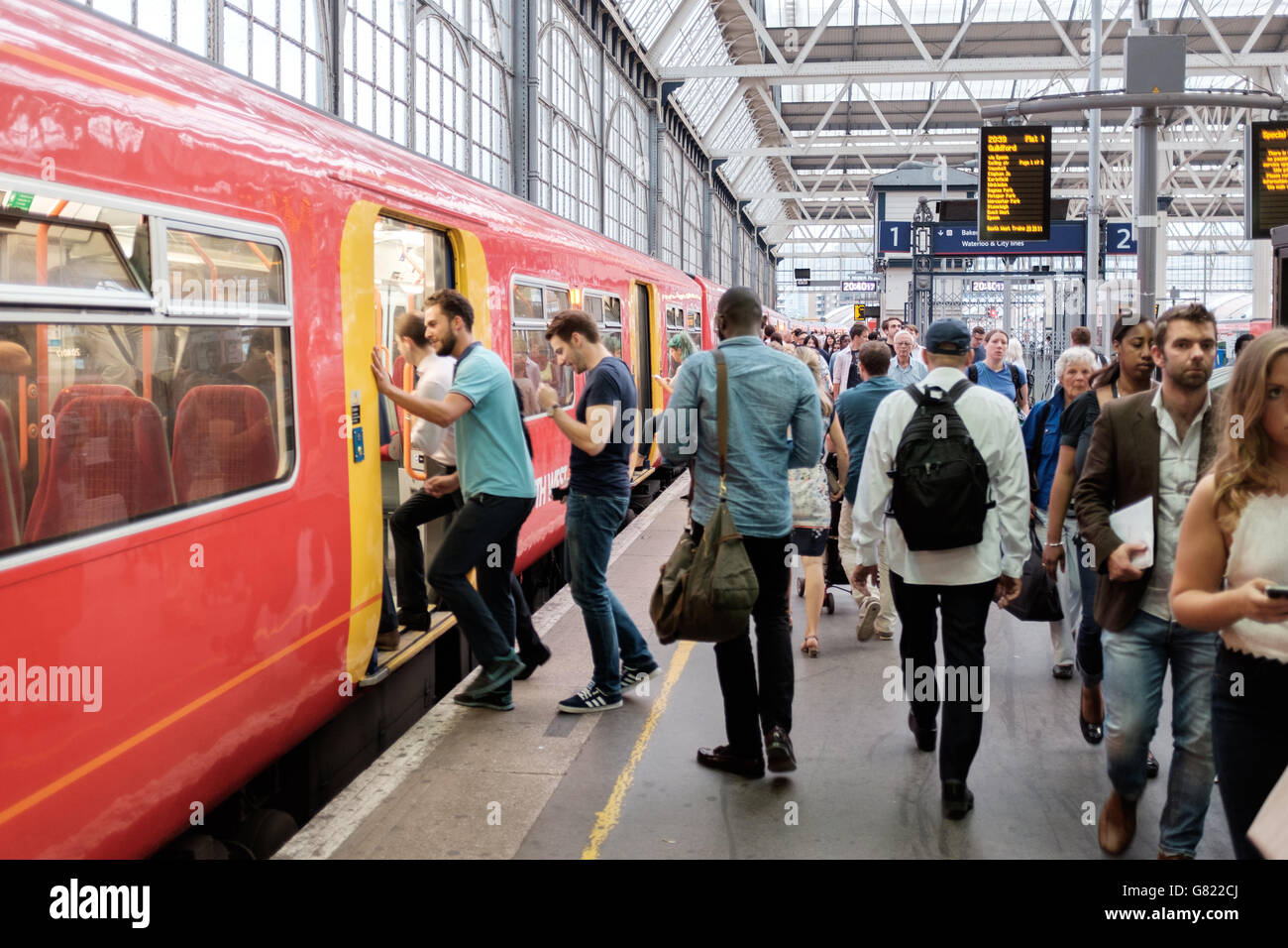 Commuters on the  train platform,Waterloo station,London,UK - Stock Image