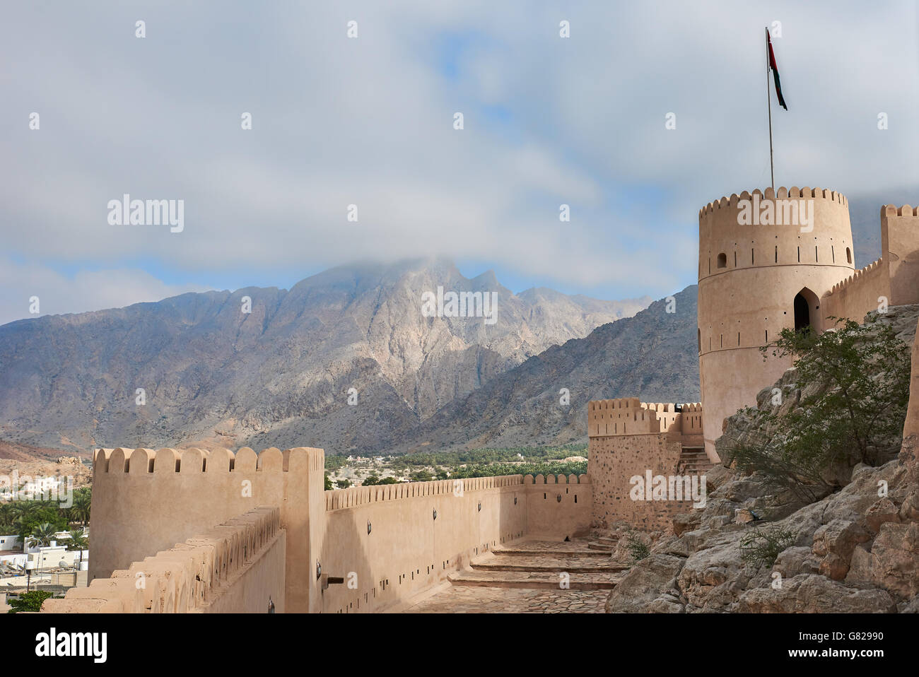 Watch tower of an ancient fort in oman against the backdrop of a blue sky Stock Photo