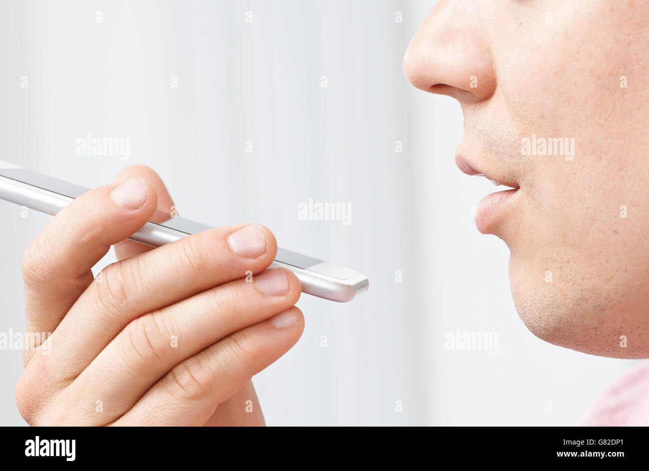 Man Using Internet Voice Search Technology On Mobile Phone - Stock Image