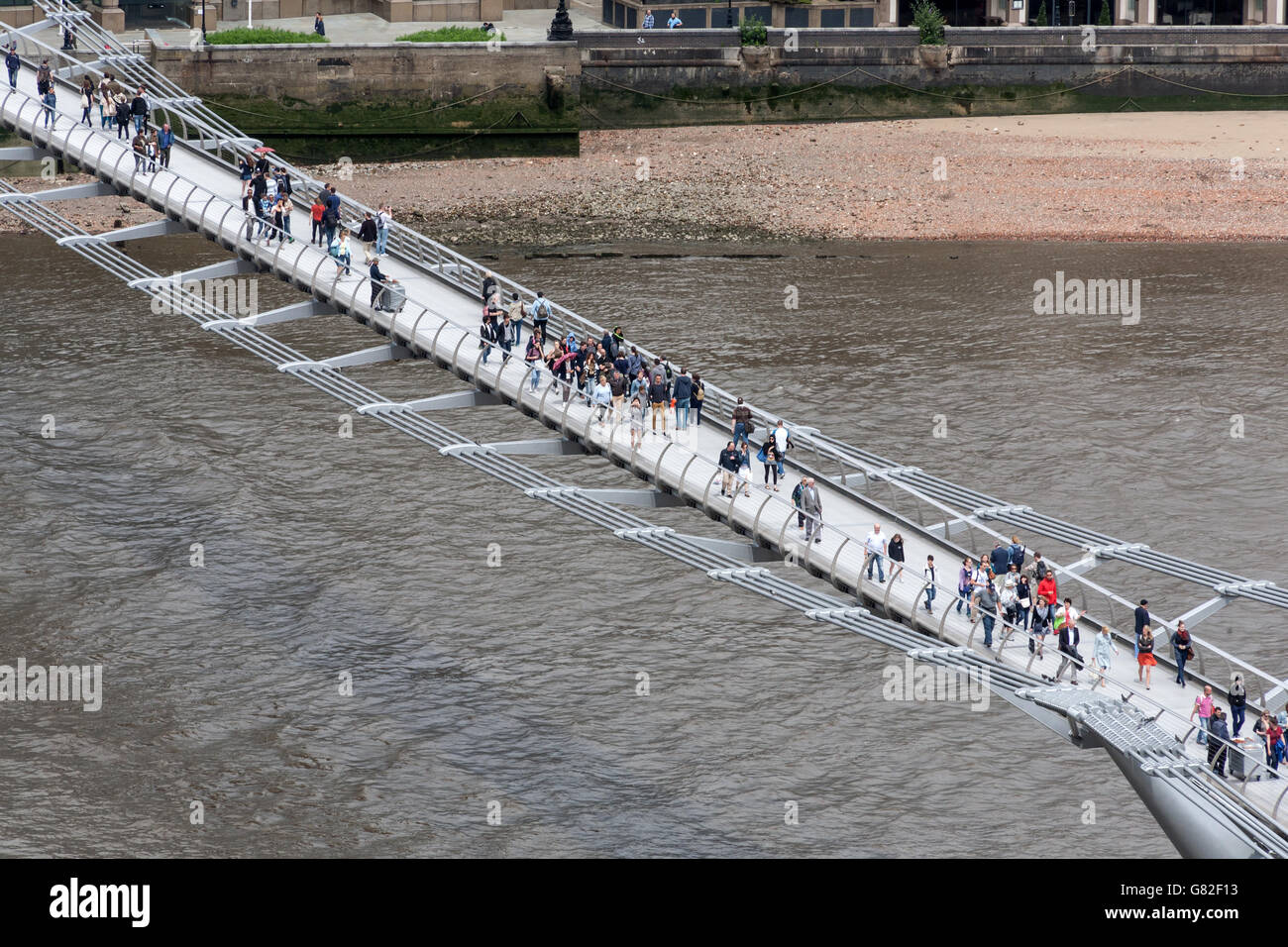 Millennium Bridge over River Thames, London, UK - Stock Image