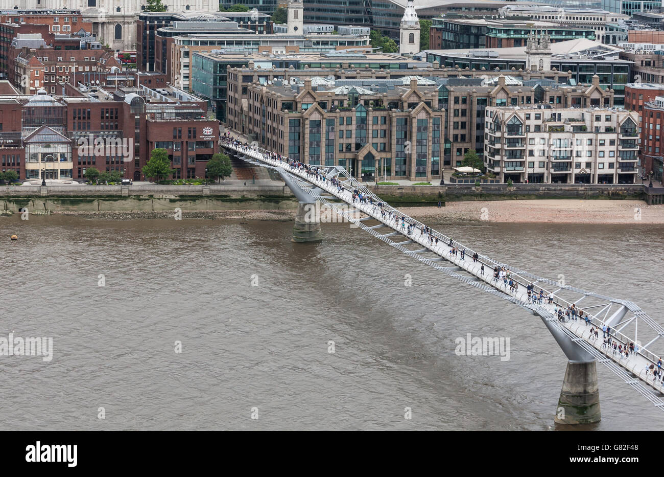 Millennium Bridge over River Thames London, UK - Stock Image