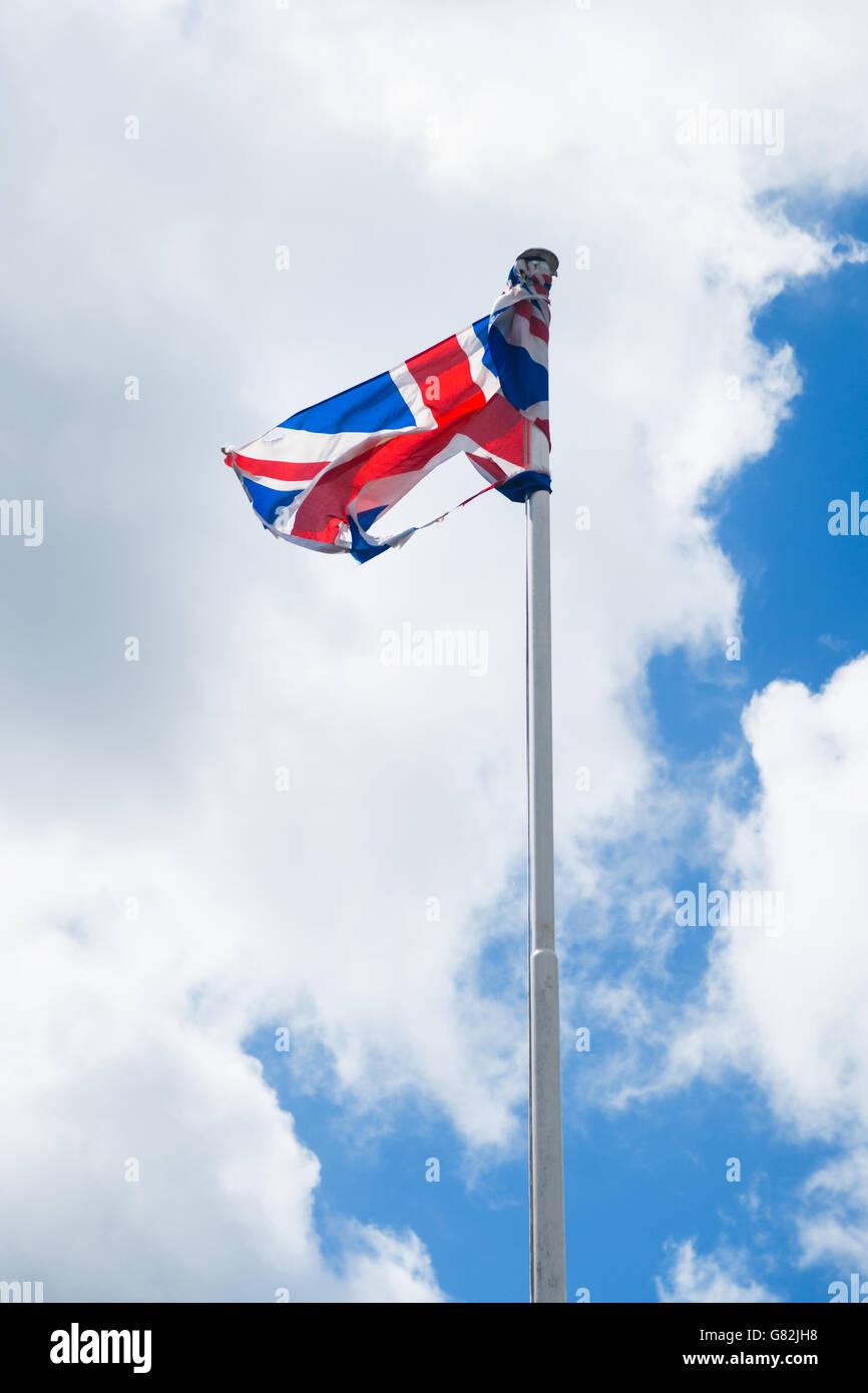 A tattered British Union Jack flag. - Stock Image