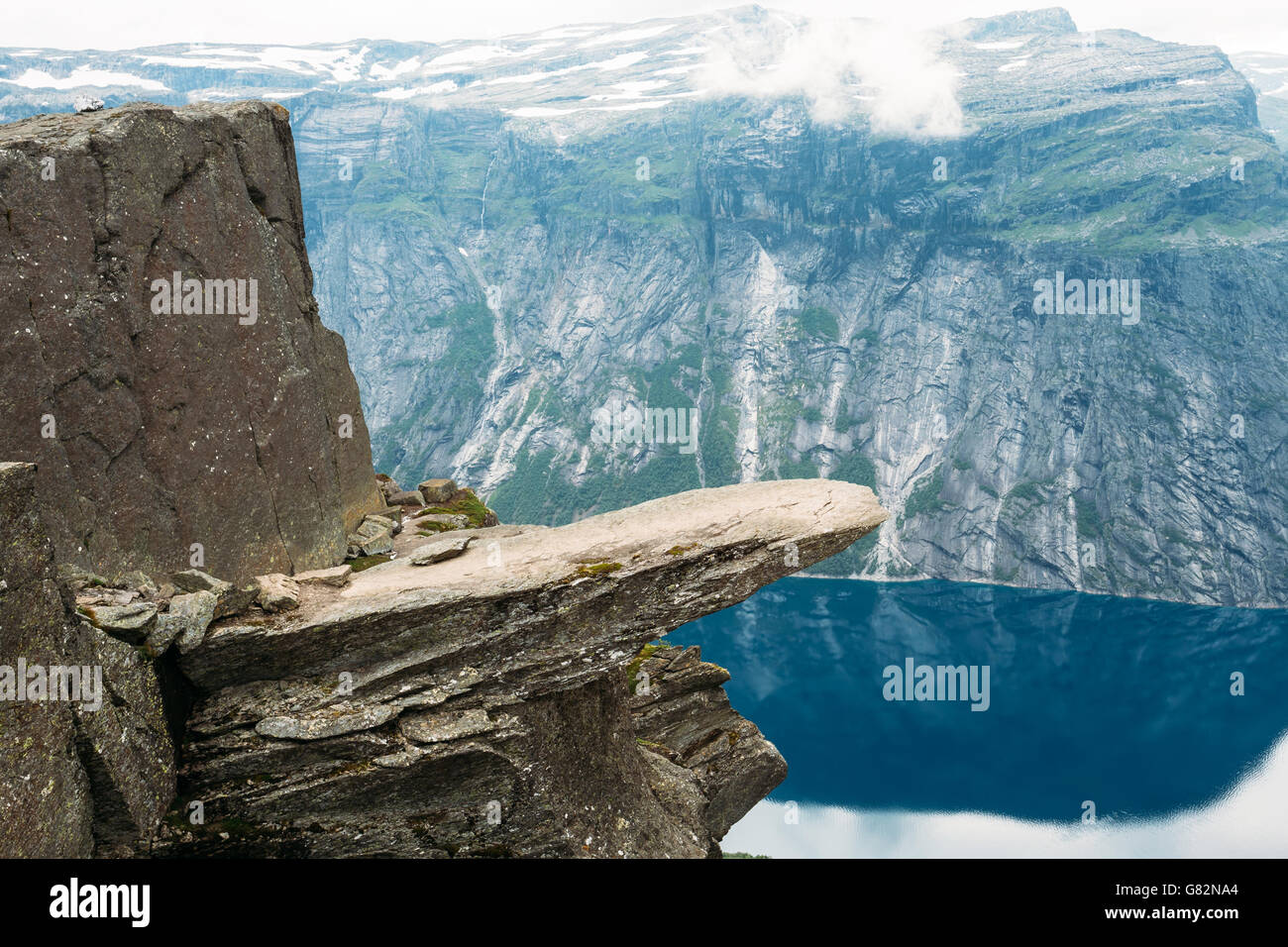 Scenic View Of Rock Trolltunga - Troll Tongue In Norway. Rock In The Mountains Of Norway. Natural Attractions Landmark - Stock Image