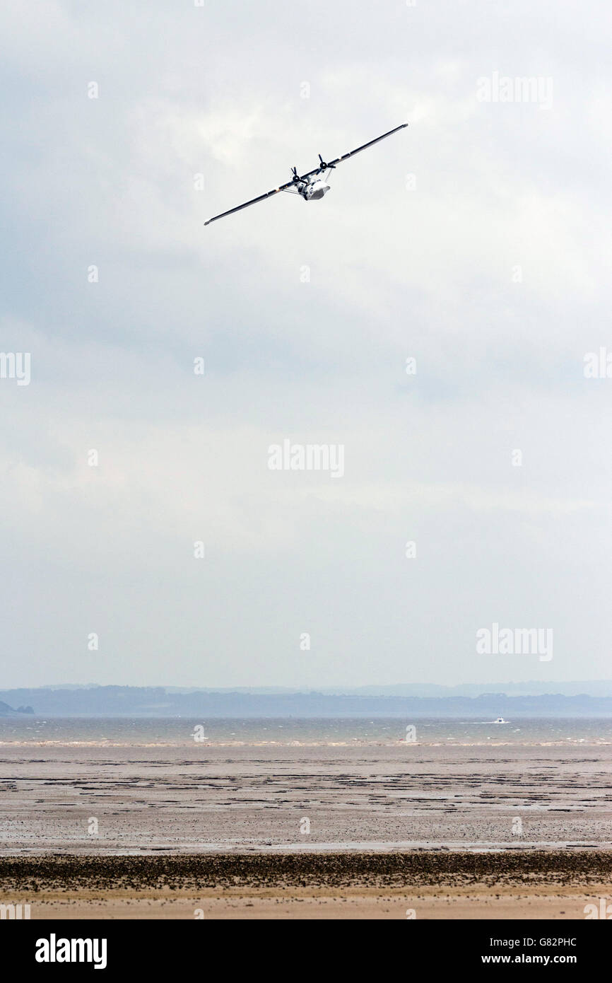 PBY Catalina Amphibian Sea Plane flying over the beach at Weston-Super-Mare, North Somerset, UK (18th June 2016). - Stock Image