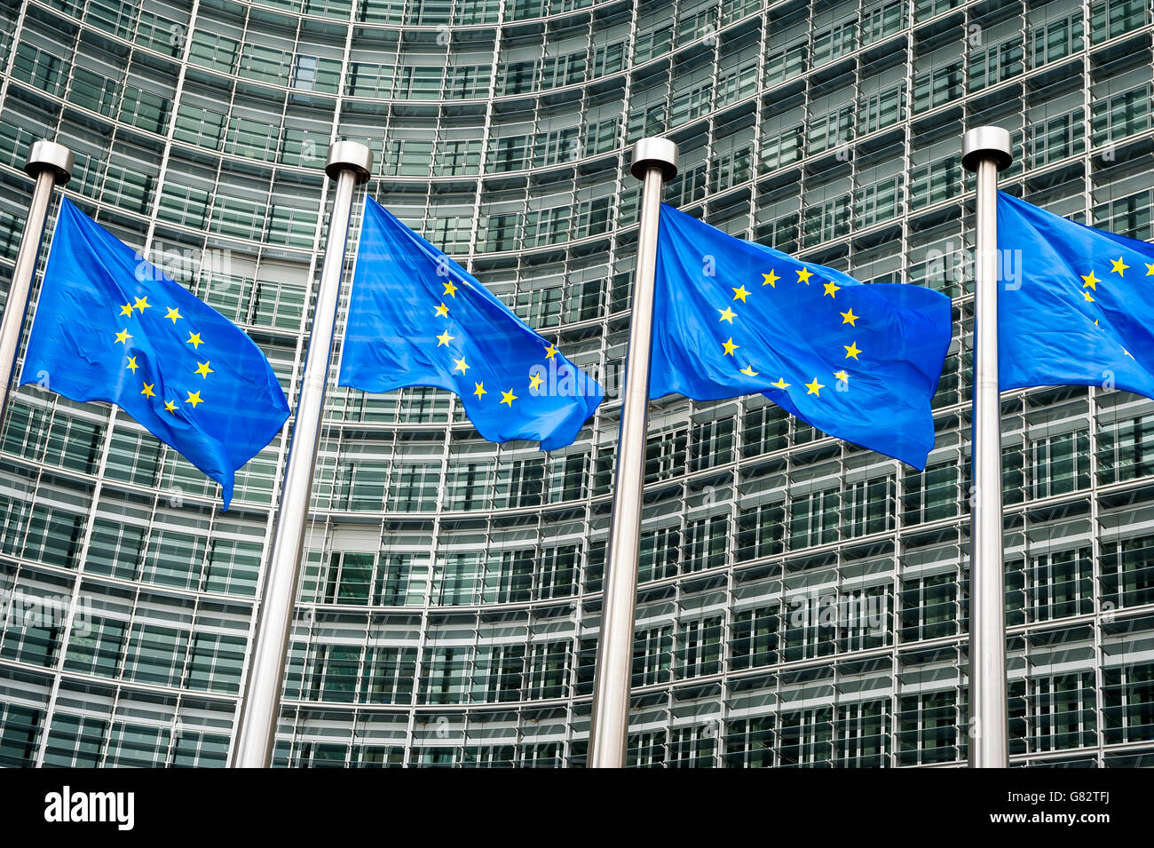 Row of EU European Union flags flying in front of administrative building at the EU headquarters in Brussels, Belgium - Stock Image