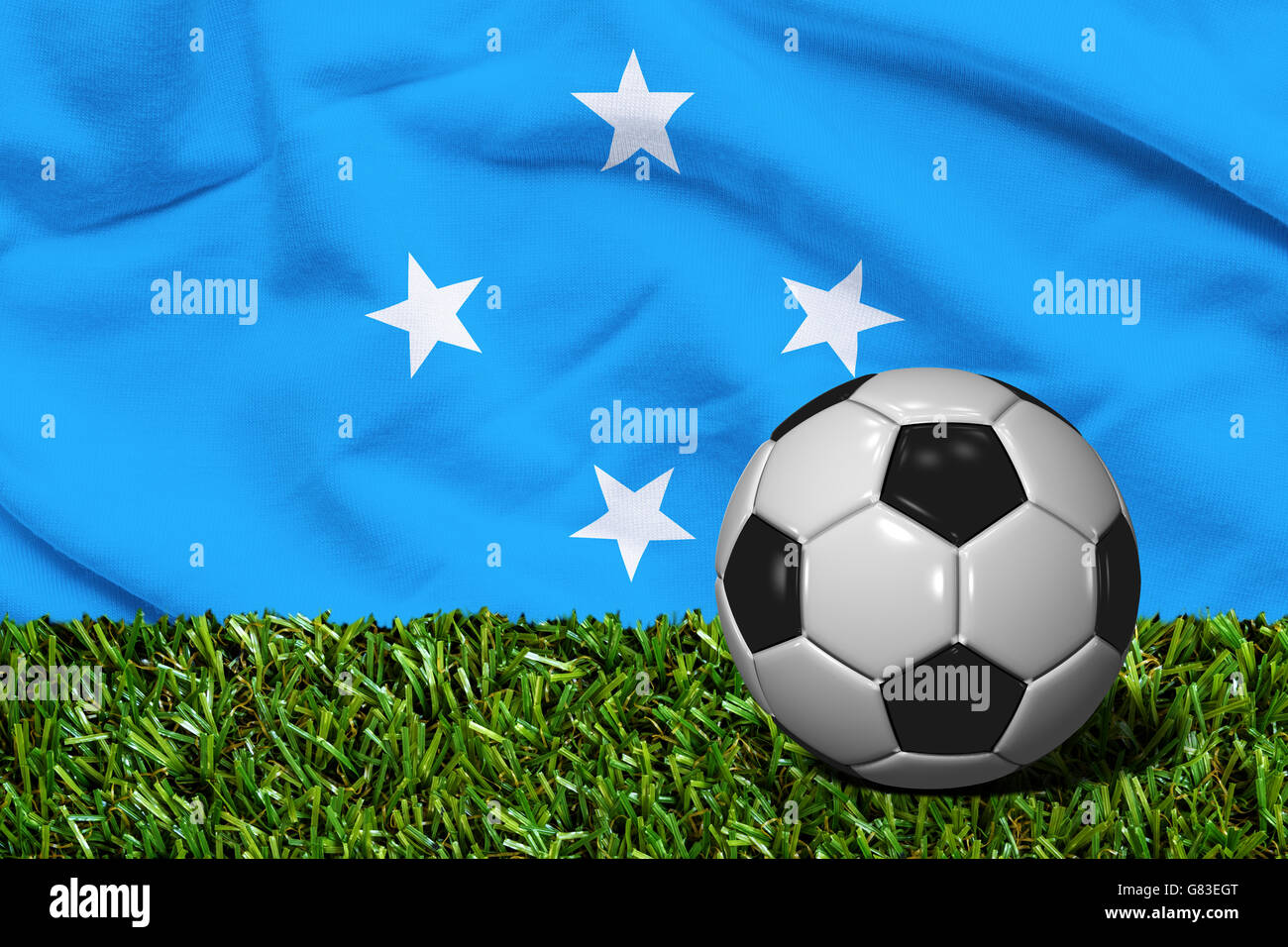 3D rendered soccer ball in grass field with Micronesia flag as Background - Stock Image