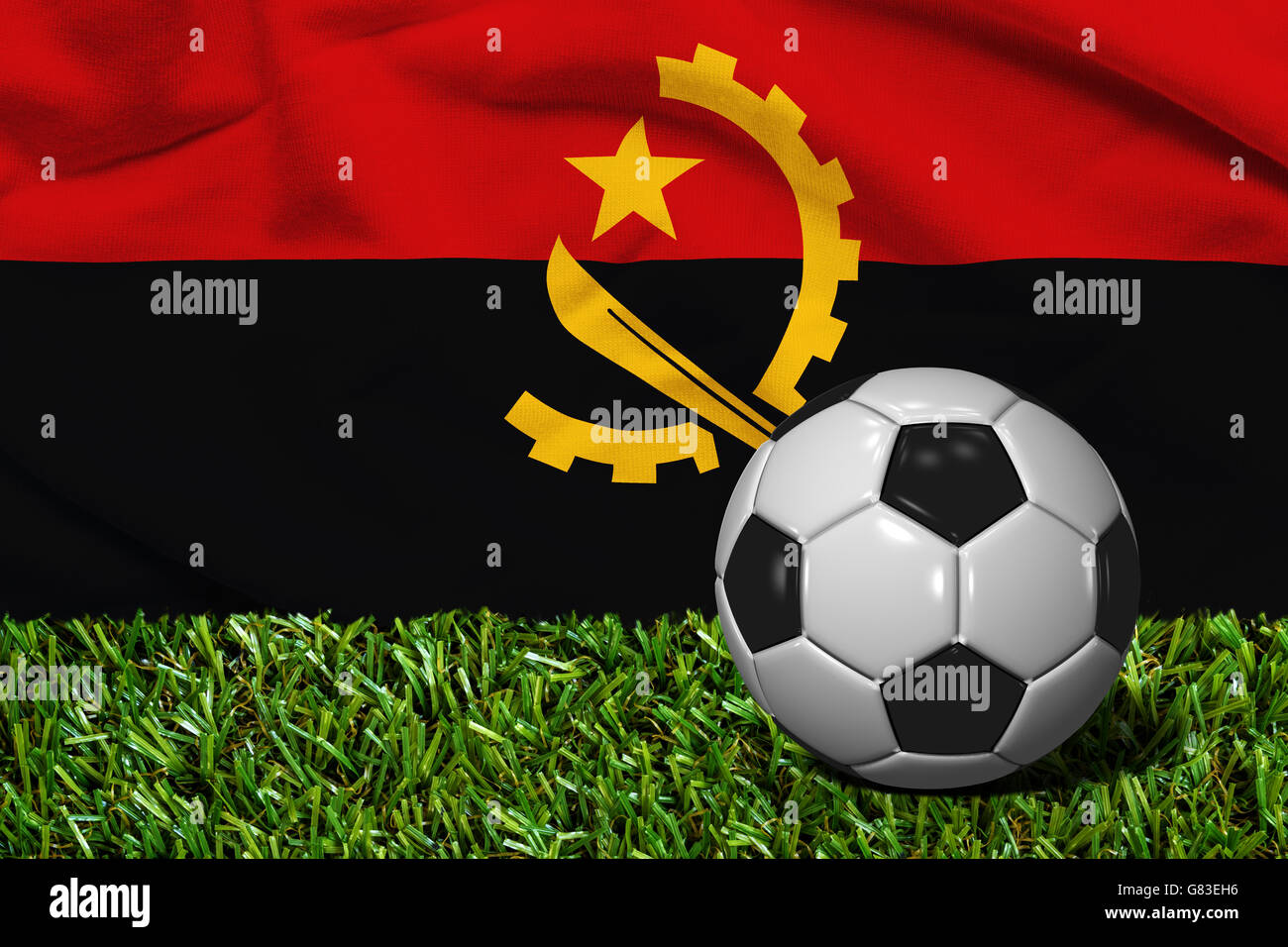3D rendered soccer ball in grass field with Republic of Angola flag as Background - Stock Image