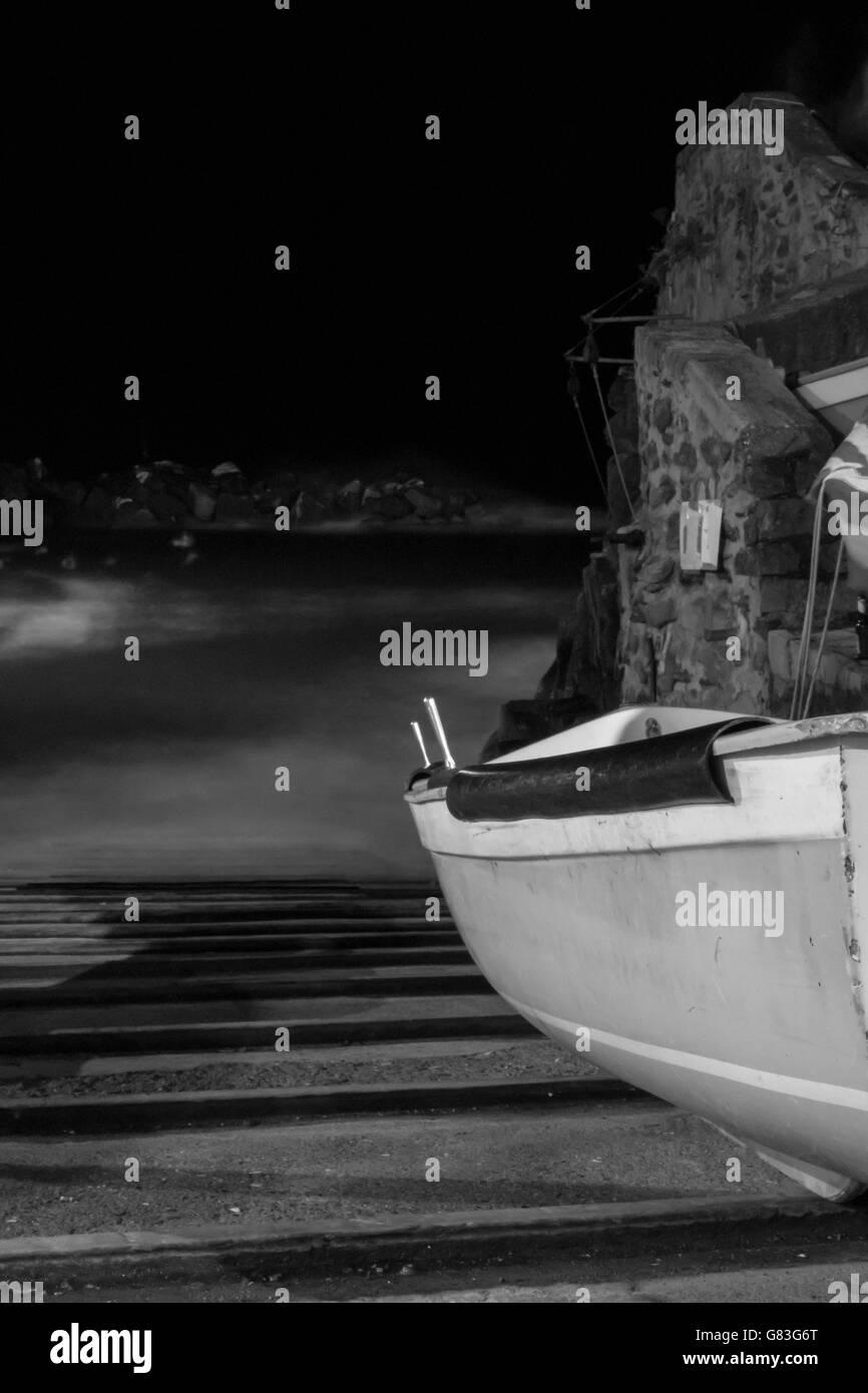 Sail boat on harbour slope italian coast - Stock Image