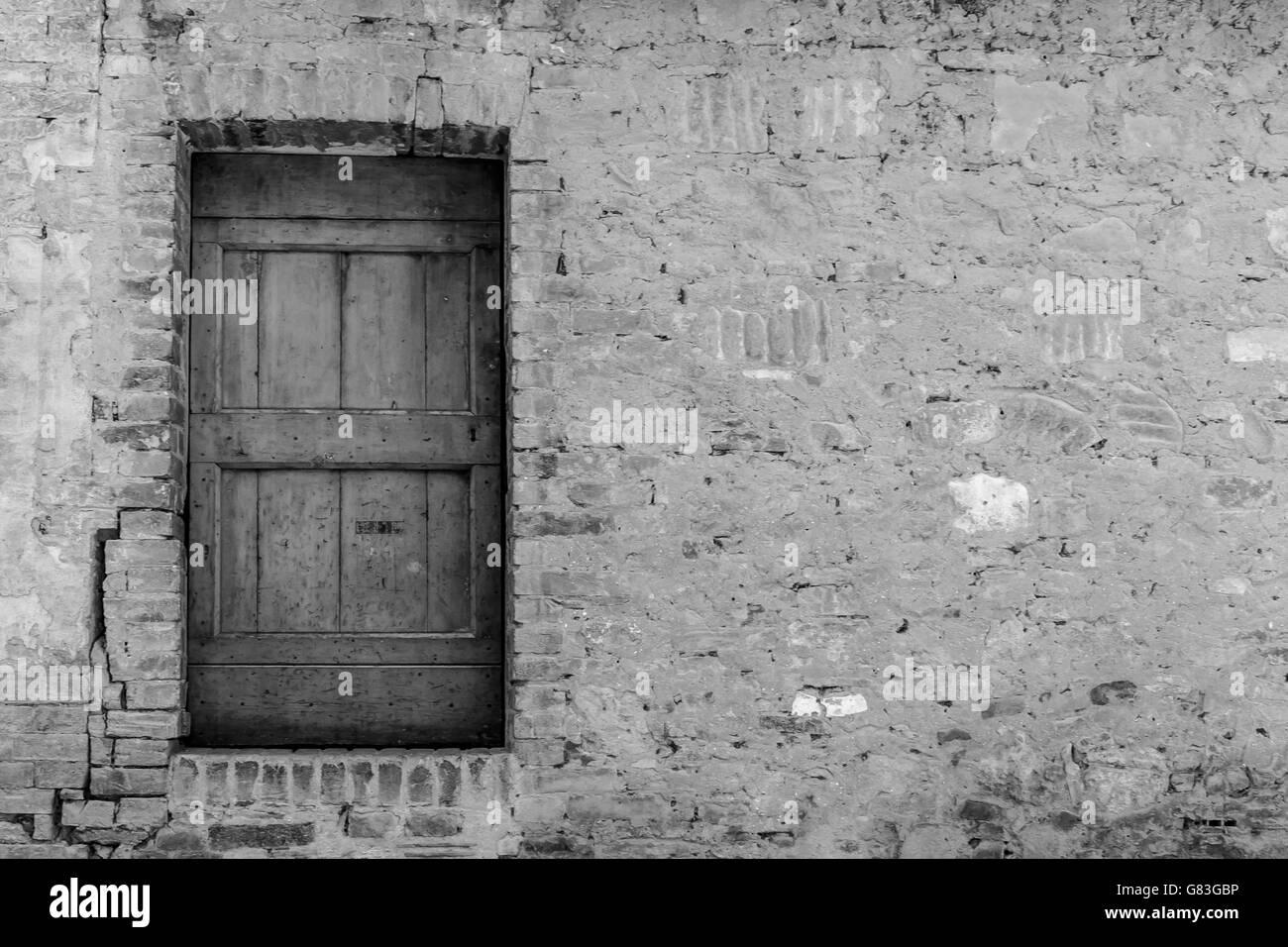 Rustic Wooden Door In Black And White Random Stonework