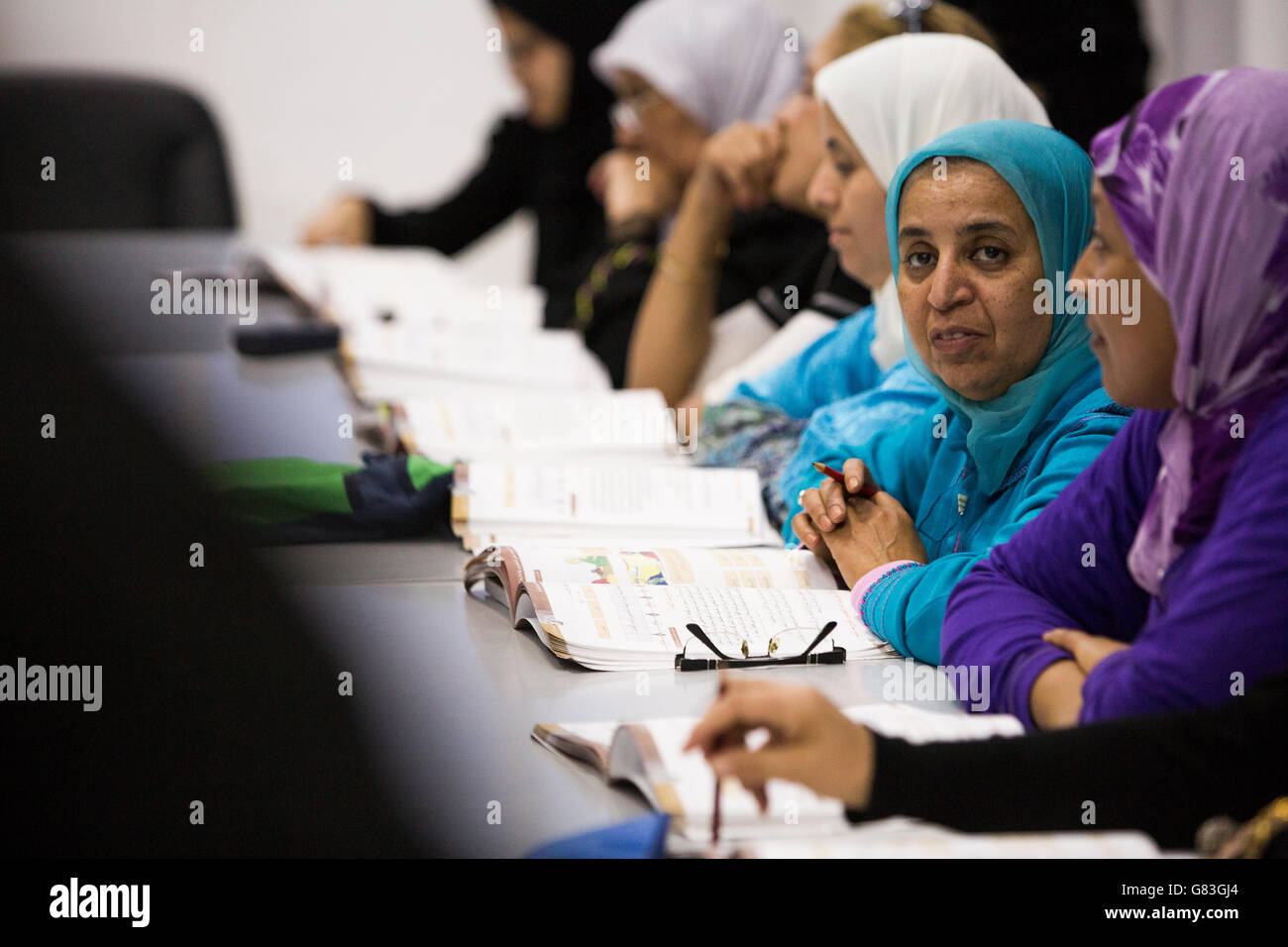 Women attend an evening functional adult literacy course in Agadir, Morocco. - Stock Image