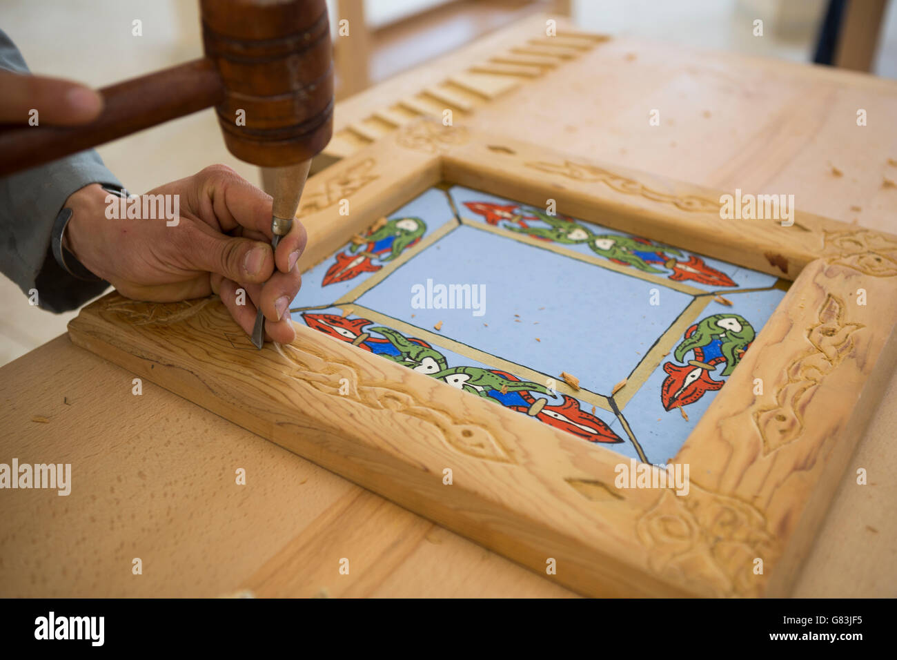 Students practice in woodworking class at the Institute of Traditional Arts in Fez, Morocco. - Stock Image