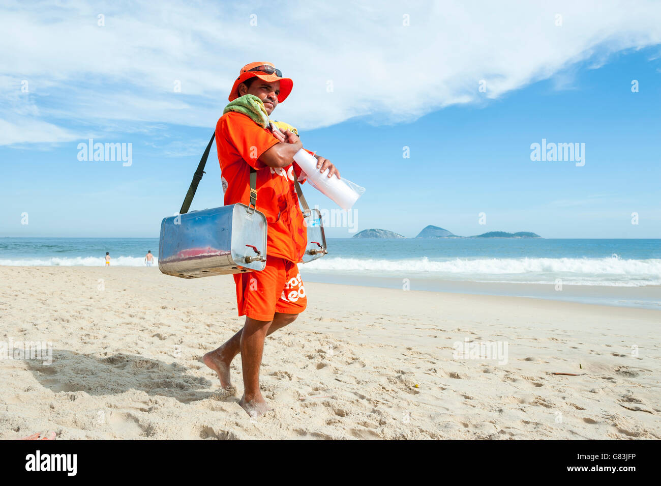 RIO DE JANEIRO, BRAZIL - MARCH 15, 2015: Brazilian beach vendor selling South American mate tea walks on Ipanema - Stock Image