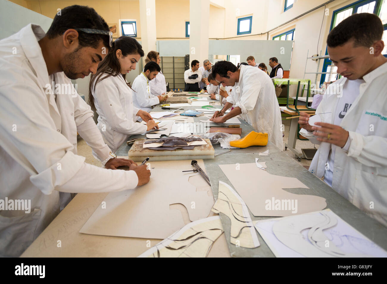 Students learn shoe making, design and leatherwork at the Institute of Traditional Arts in Fez, Morocco. - Stock Image
