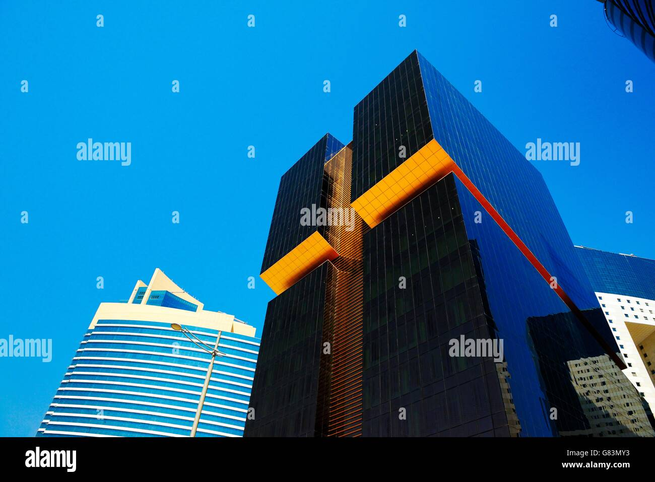 City centre Doha, Qatar. Towers line Majlis Al Taawon Street. Left Qatar Petroleum District Tower. Right Golden - Stock Image