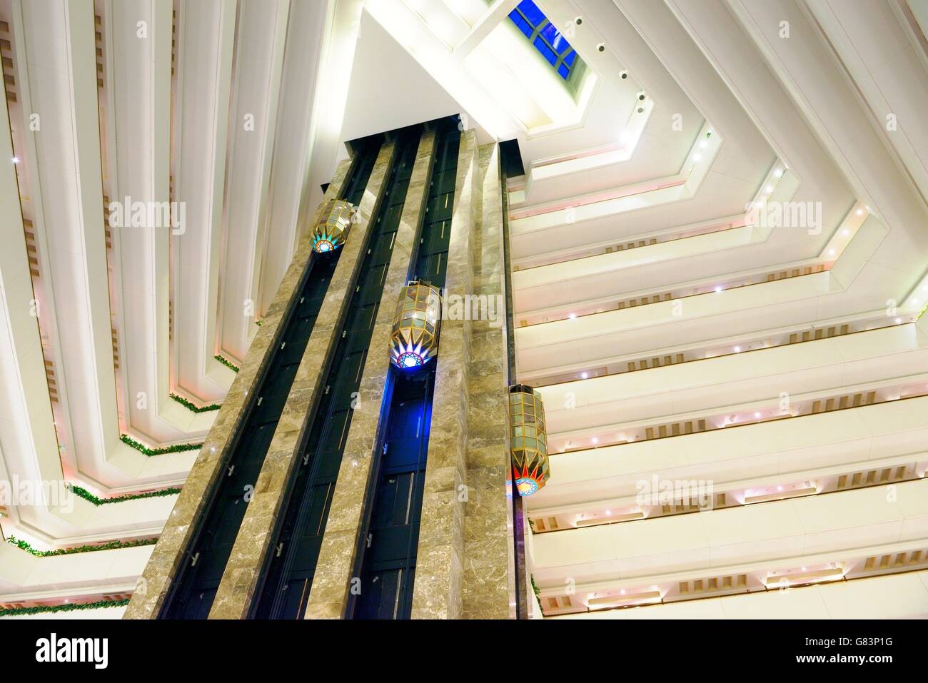 The Sheraton Grand Doha Resort and Convention Hotel on the Corniche in West Bay, Doha, Qatar. Elevators in the central - Stock Image
