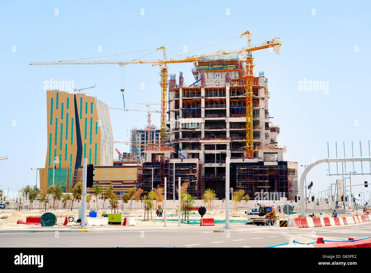 Al Bandary Engineering's Commercial Tower under construction. Marina District of rapidly developing new city - Stock Image