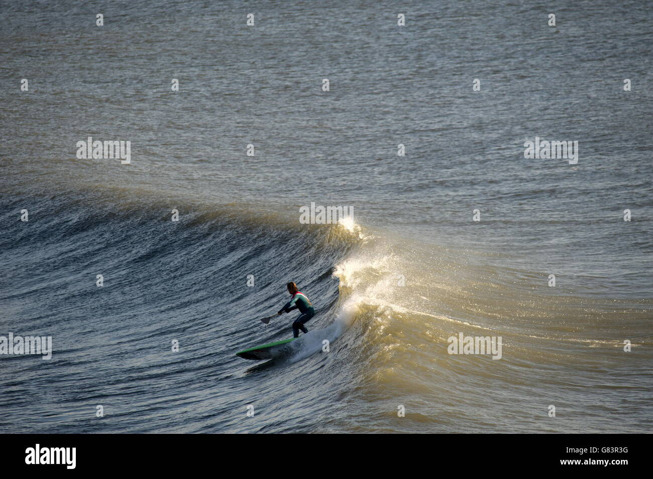 Take off on a perfect wave .Surfers eye view of swell above  a Gower point break in Wales, UK - Stock Image