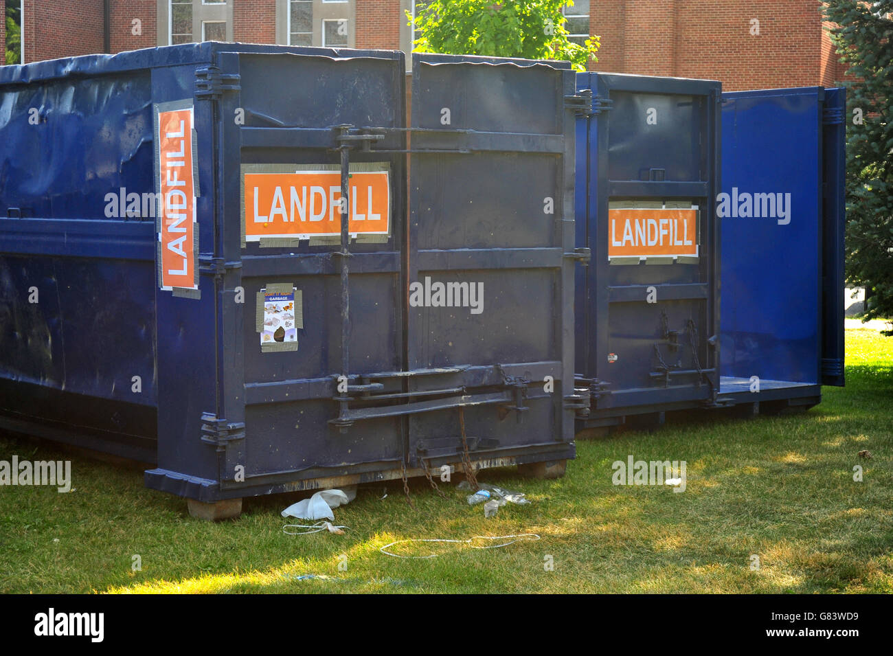 Two large landfill containers placed at the side of a city festival in London Ontario. - Stock Image