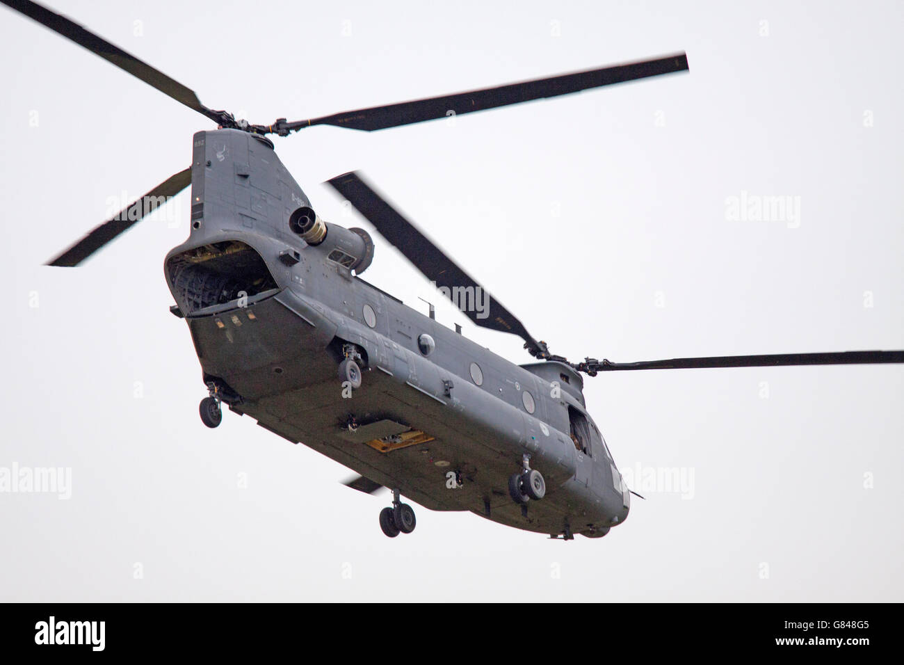 LEEUWARDEN, NETHERLANDS - JUNI 11 2016: Chinook CH-47 military helicopter in action during a demonstration flight - Stock Image