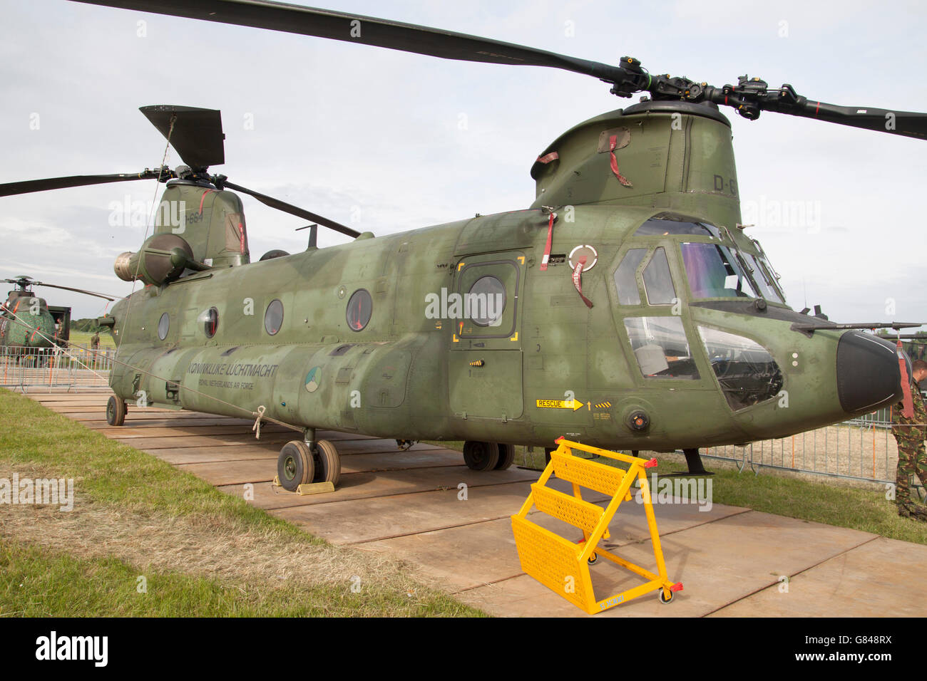 LEEUWARDEN, NETHERLANDS - JUNI 11 2016: Parked green Chinook CH-47, Tandem rotor military helicopter. - Stock Image