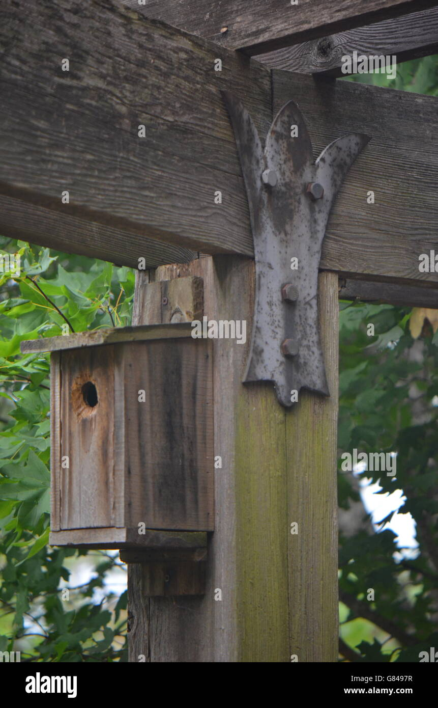 Arbor With Post & Beam and Birdhouse - Stock Image