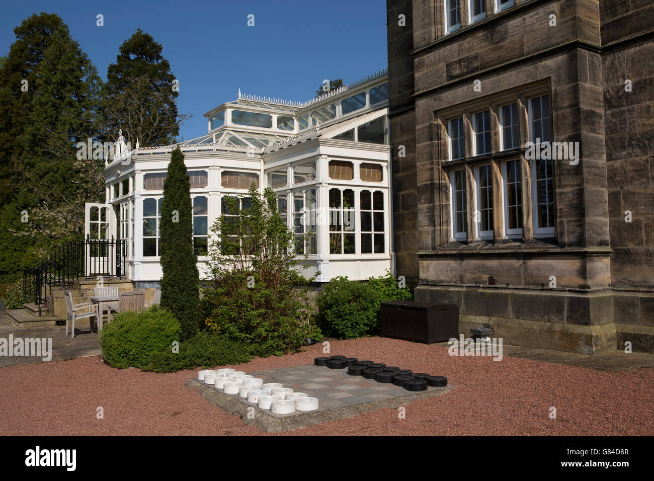 A draughts set outside of Matfen Hall in Northumberland, England. - Stock Image