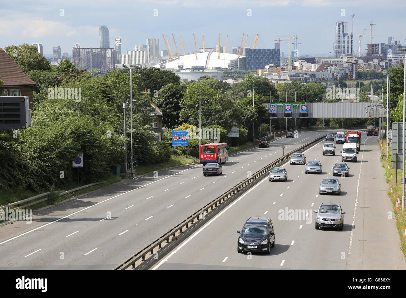 The A2 dual carriageway approaches the Blackwall Tunnel and London Docklands. Shows the Millennium Dome and London - Stock Image