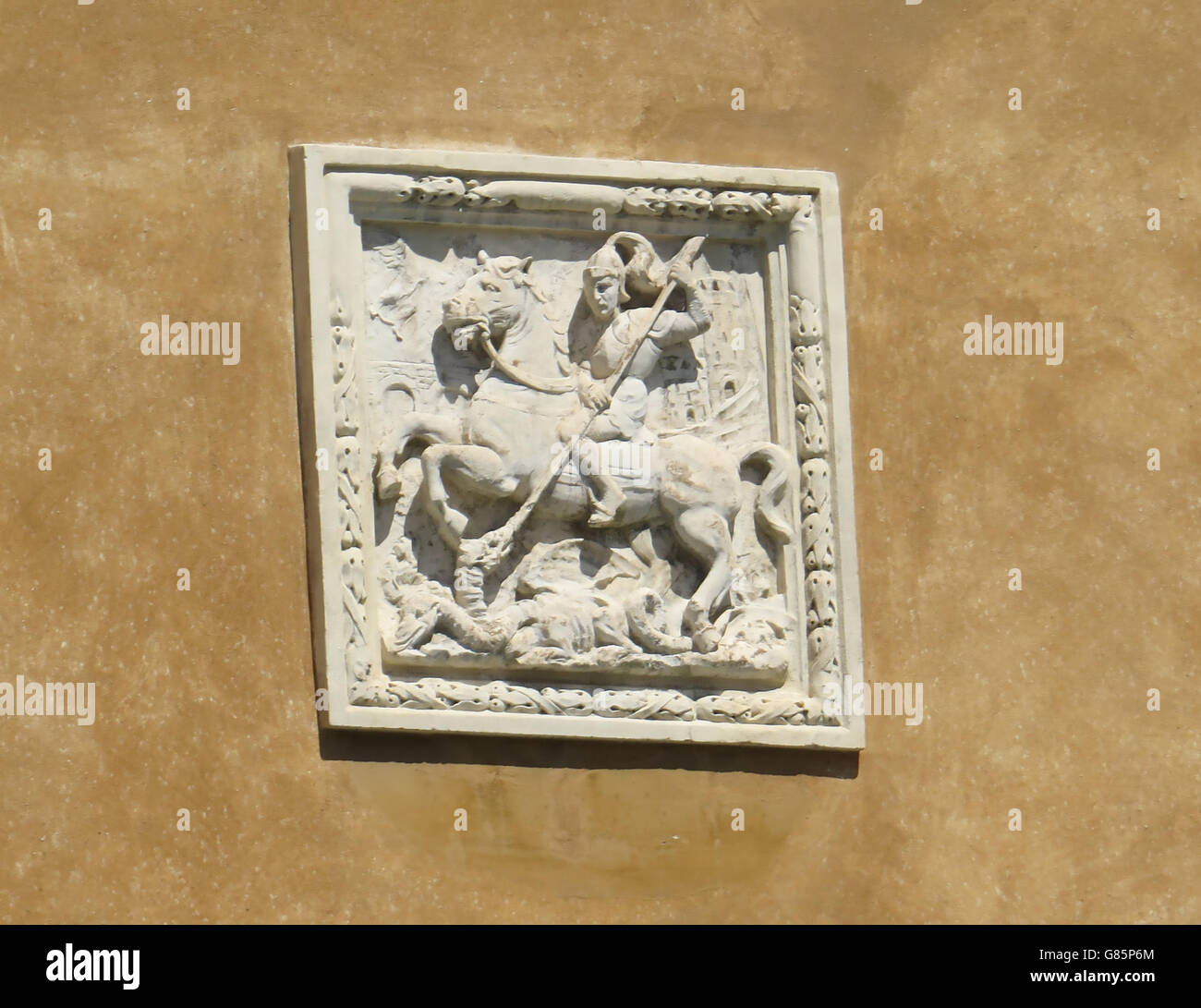 VENICE, Italy.  St George and the Dragon in a plaque alop0nbg the Grand Canal. Photo Tony Gale - Stock Image