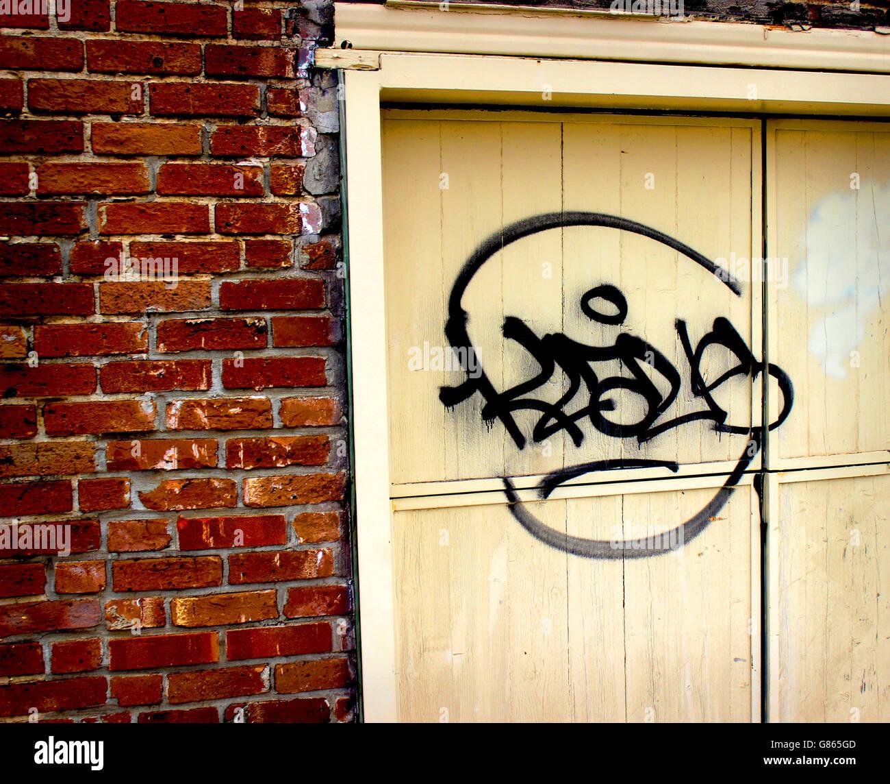 A door, a wall, and Graffiti - Stock Image