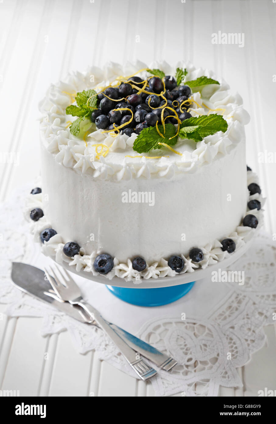 Blueberry Cake With Vanilla Icing Decorated With