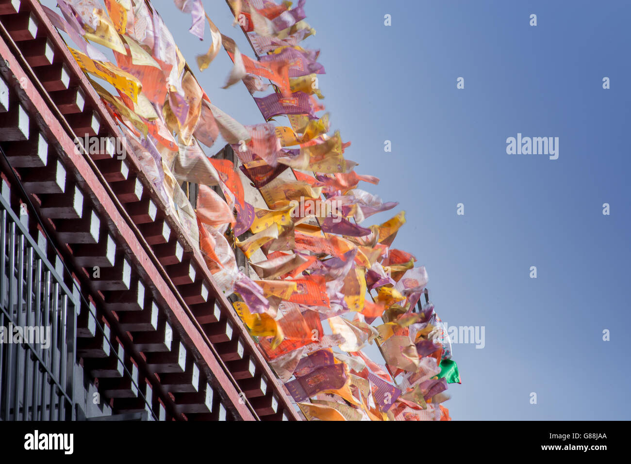 Prayer flags on the rooftop in Tibet - Stock Image