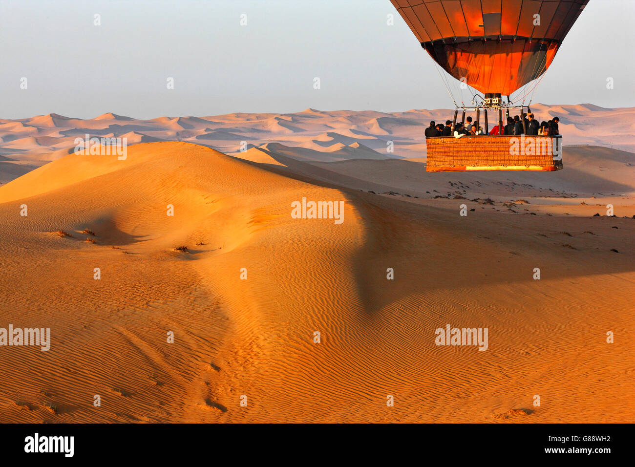 Flying over desert in hot air balloon, Dubai - Stock Image