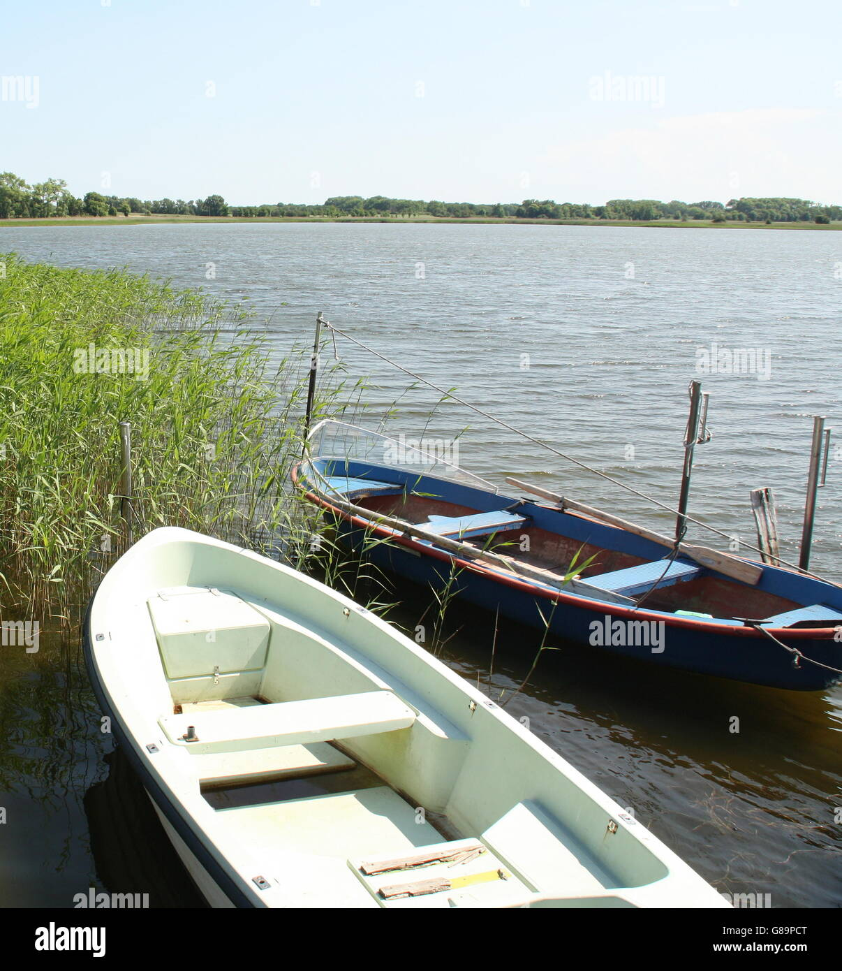 Boats in the bay of Nature reserve Neuendorfer Wiek on the island Rügen.Germany - Stock Image