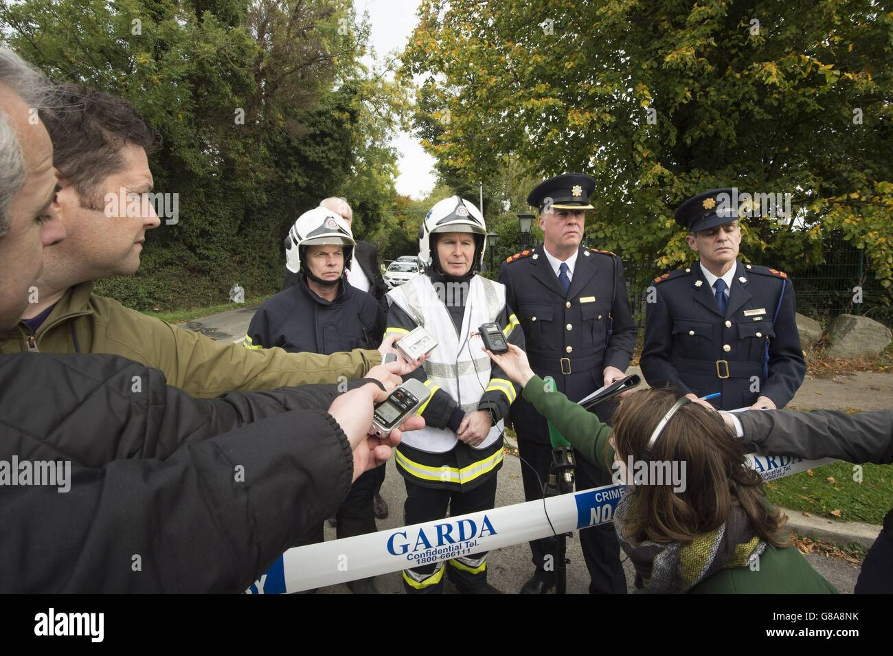 Gerry Stanley, Dennis Keeley, assistant chief fire officer Dublin City Fire Brigade, Superintendent Diarmuid O'Sullivan - Stock Image