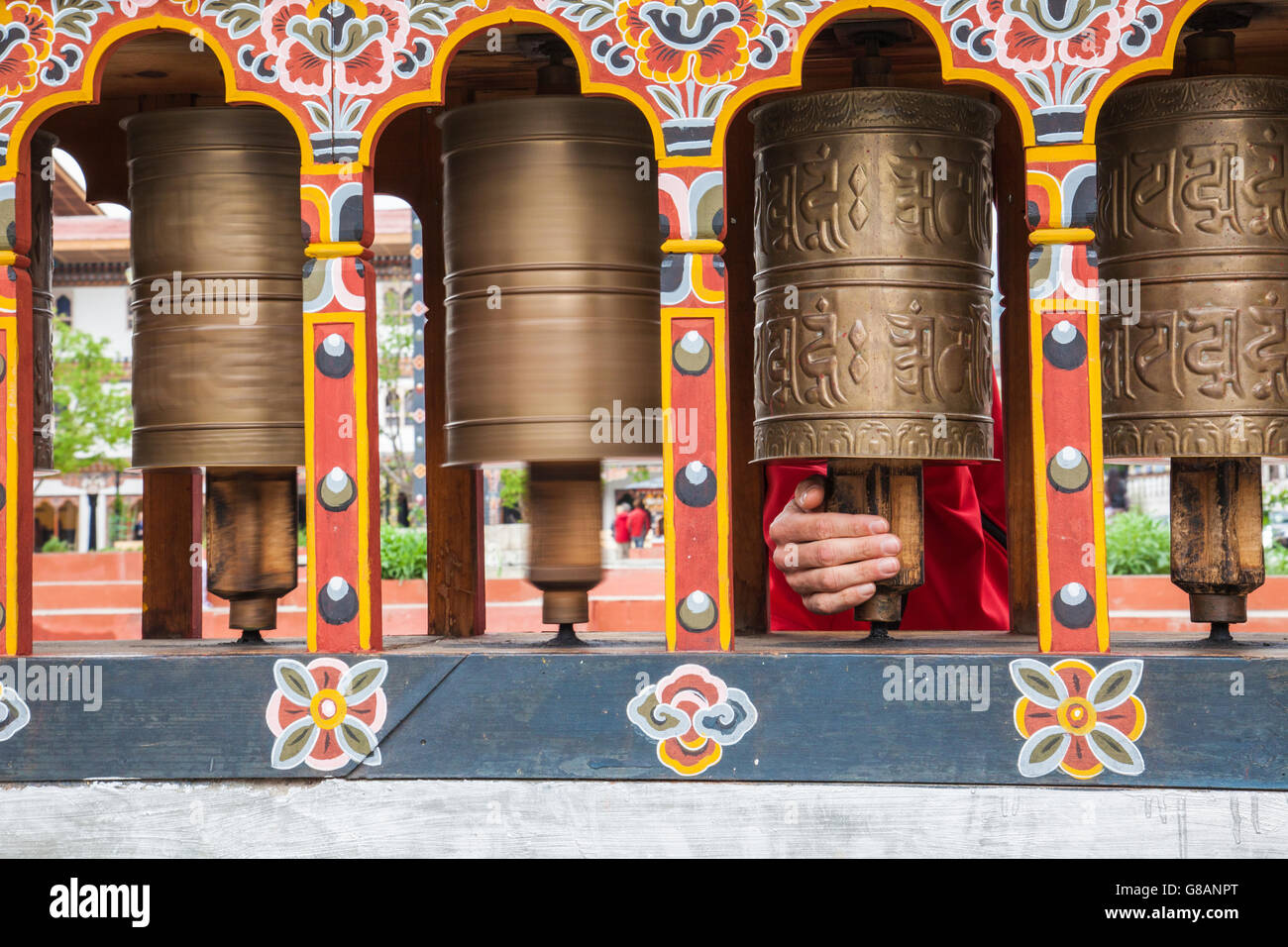 Typical prayer wheels used by Buddhists  to accumulate wisdom and merit and to purify negativities Thimphu Bhutan - Stock Image