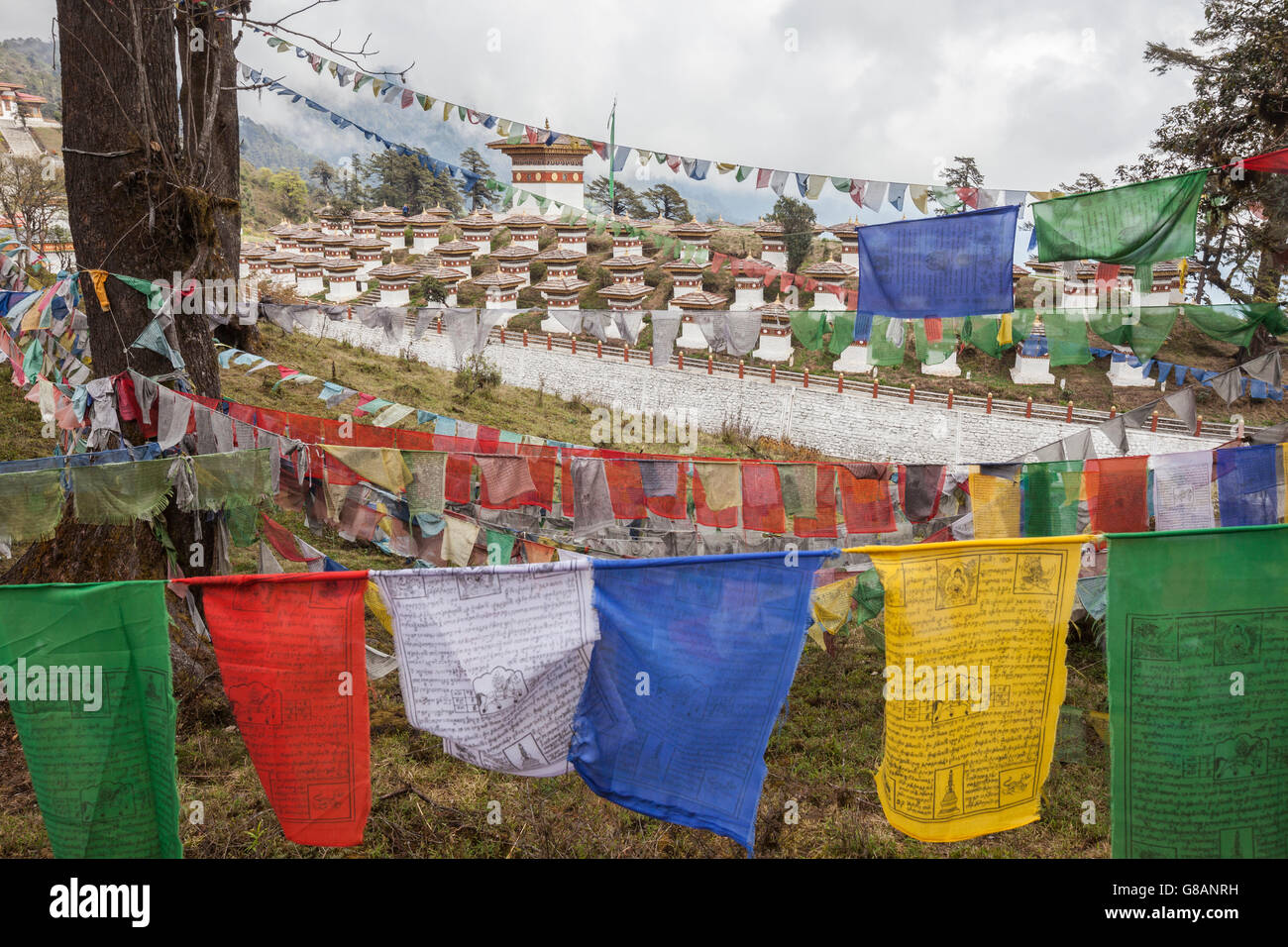 Colorful flags symbol of Buddhist prayers close to sacred temples Thimphu Wangdue Bhutan Asia - Stock Image