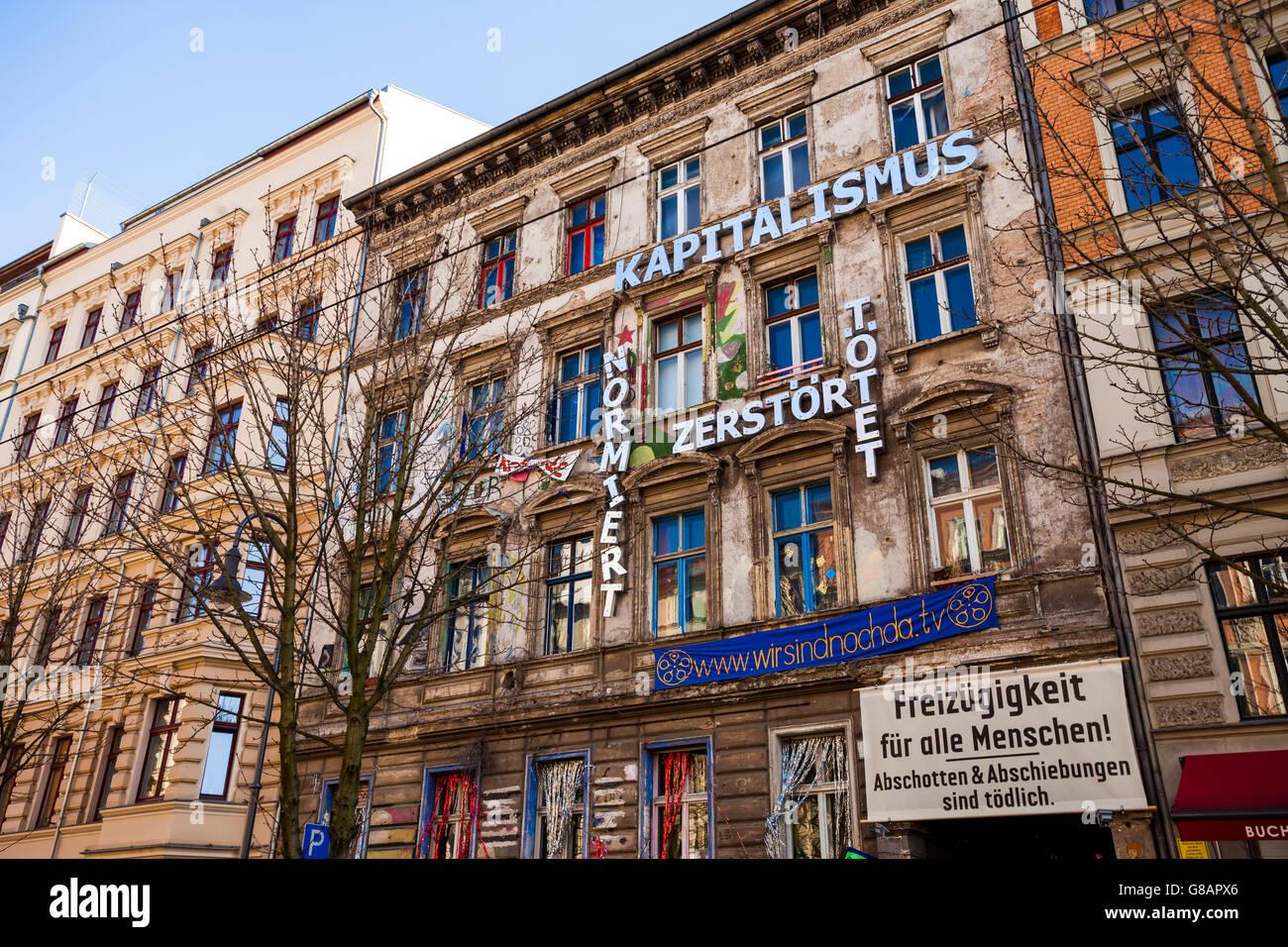 Anti-capitalist sign on the Kastanienallee 86, Berlin, Germany - Stock Image