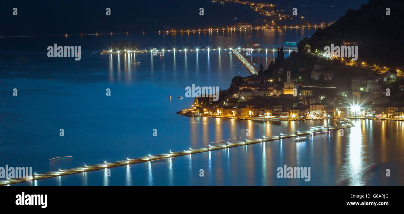 The floating piers - Christo on Iseo lake in Italy by night - Stock Image
