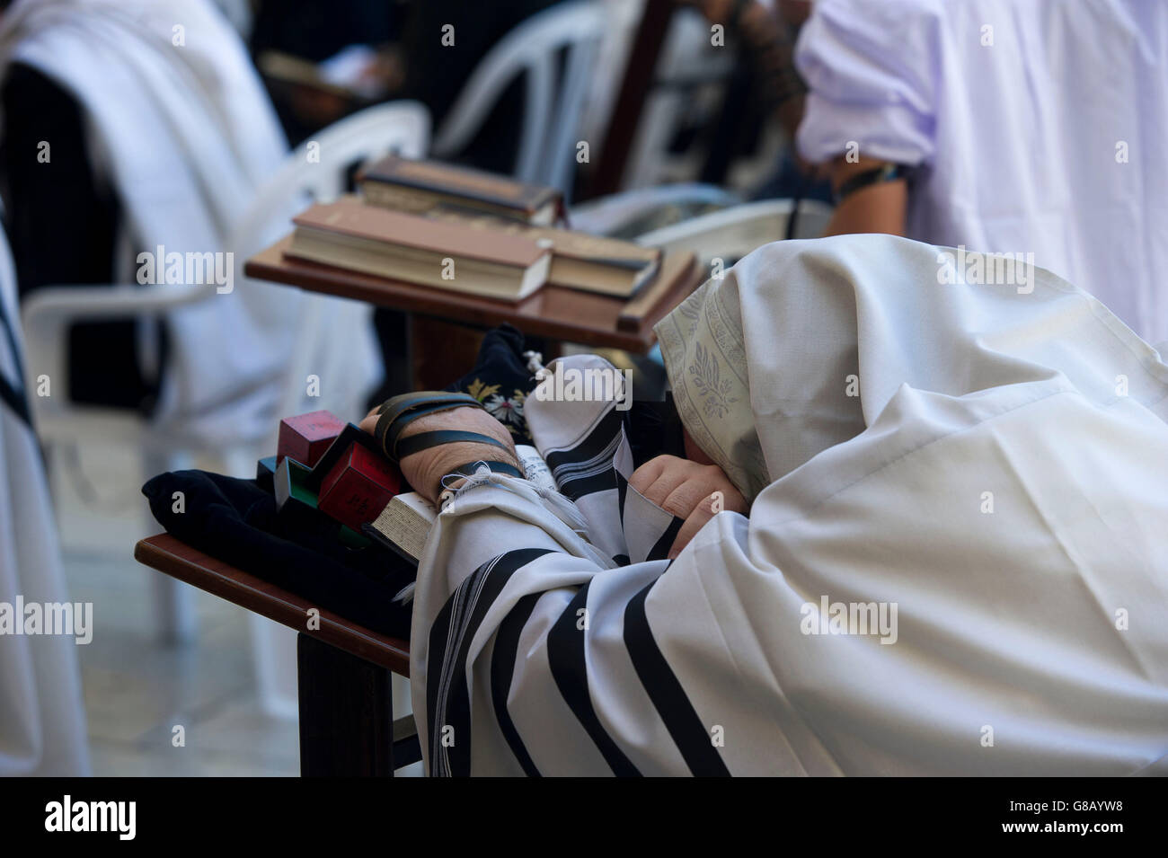 Men praying at the Wailing Wall, Jewish Quarter of the Western Wall Plaza, Old City, Jerusalem, Israel, Middle East. - Stock Image