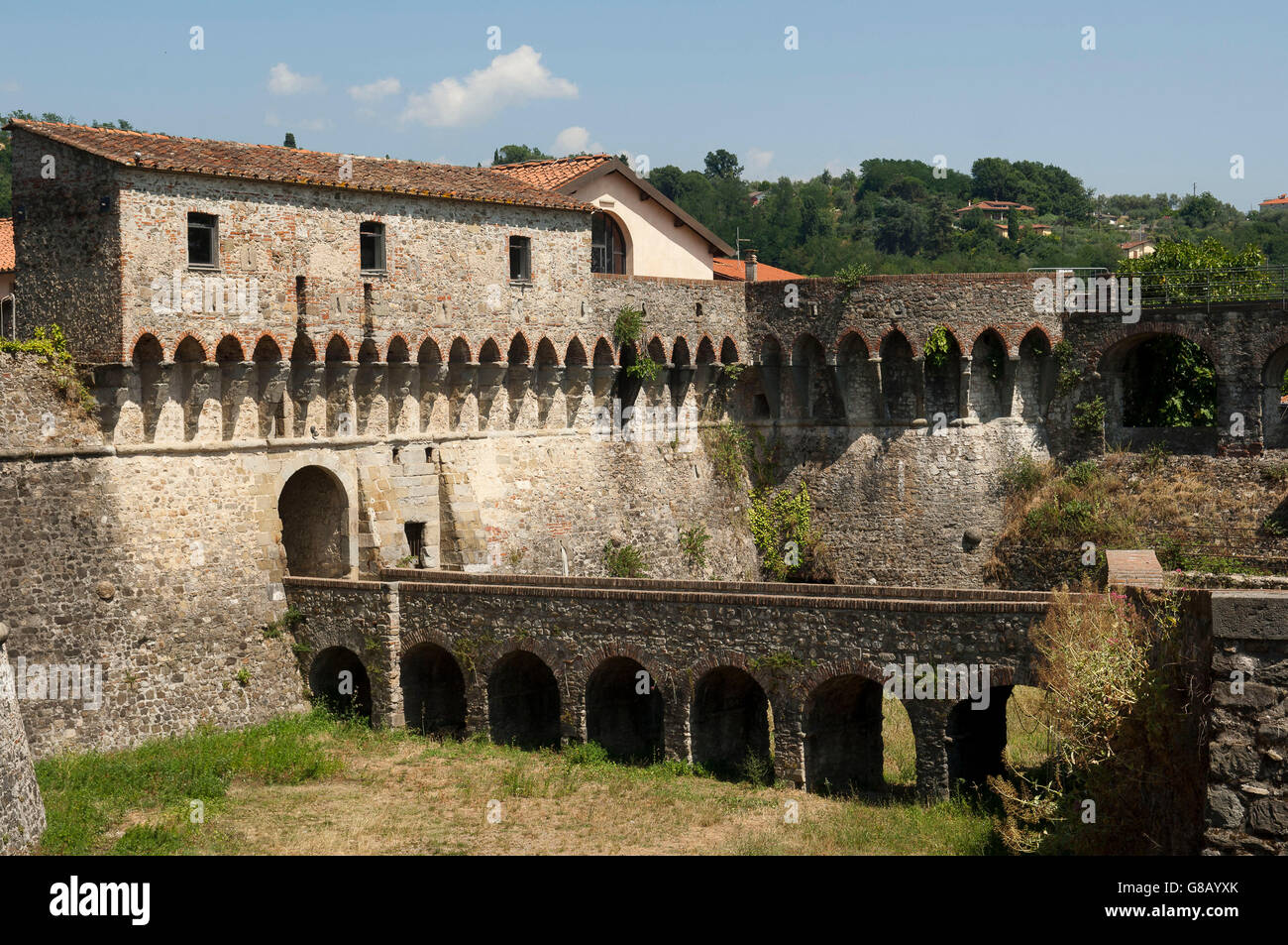view of round dungeon on ancient Castle dry moat, shot on a sunny spring day, Sarzana, Liguria, Italy - Stock Image